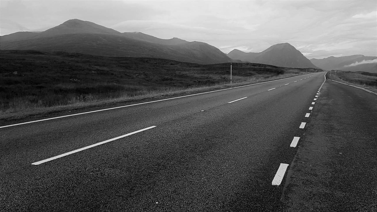 road, mountain, road marking, transportation, the way forward, mountain range, landscape, nature, white line, outdoors, asphalt, no people, tranquility, day, tranquil scene, scenics, sky, beauty in nature
