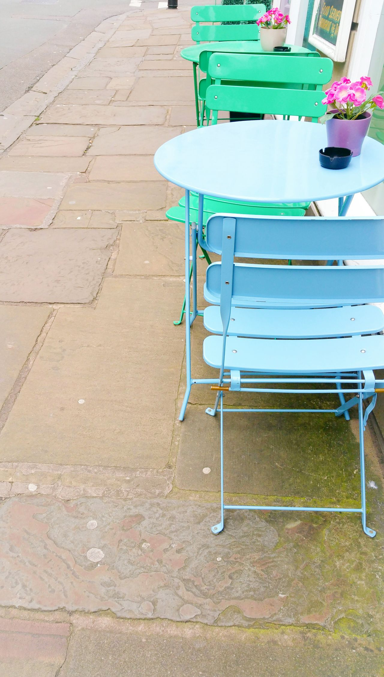 Green and Blue Chairs No People Outdoors Day Street Cafe Metal Pink Flowers Flowerpots Britain Pavement Sidewalk