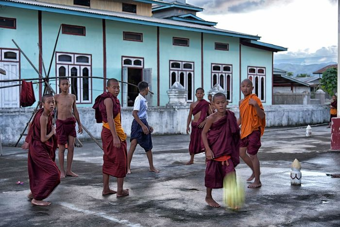 Playtime Adult Architecture Boy Building Exterior Built Structure Day Full Length Large Group Of People Lifestyles Men Monastic Monks Outdoors People Real People Sky Soccer