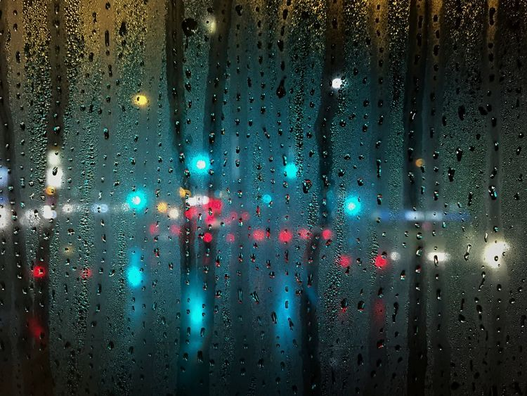 Songs from the top deck From A Bus Window Rain Backgrounds Multi Colored Illuminated Close-up No People Point Of View Sky RainDrop Outdoors Flying High