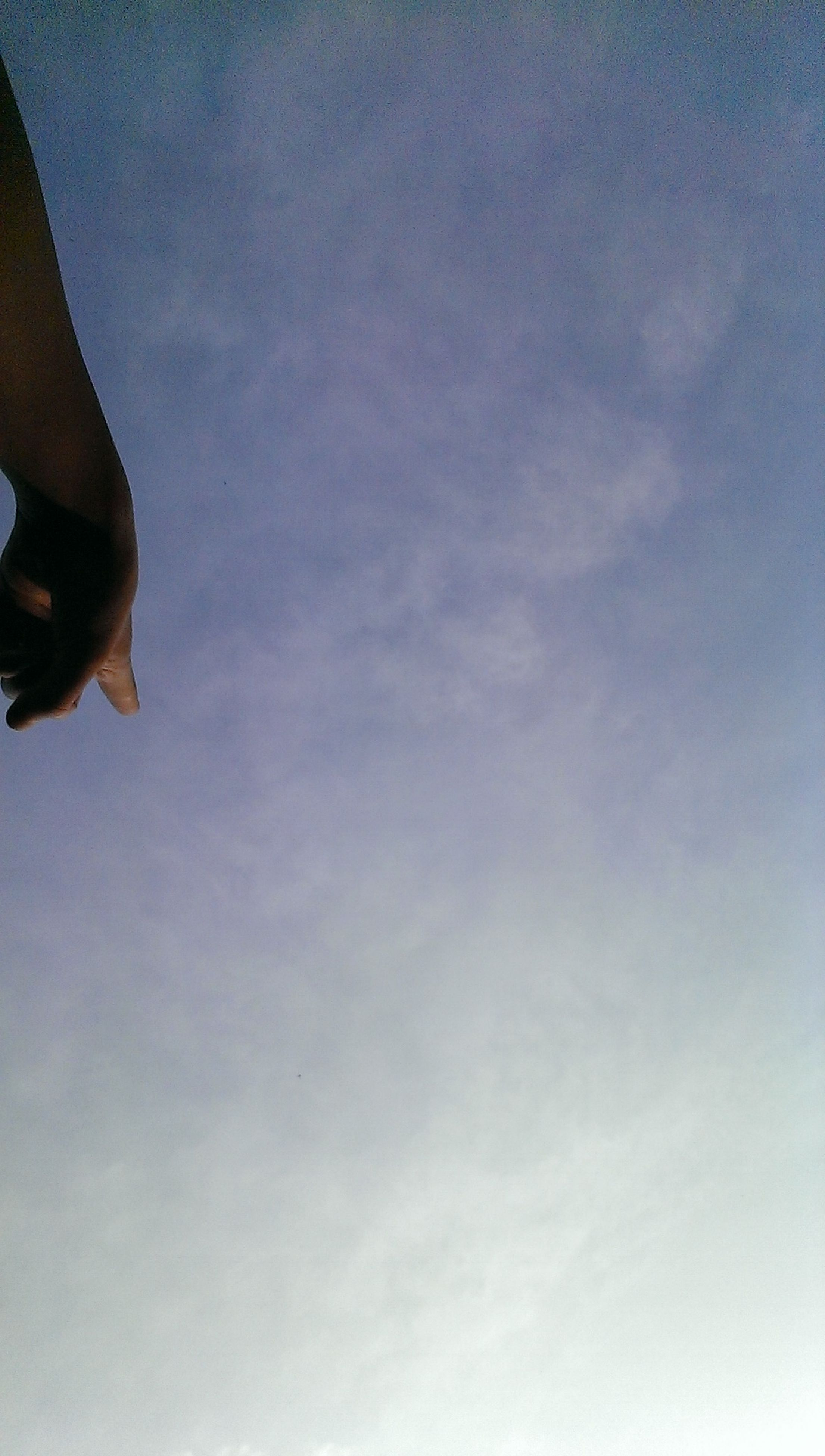 low angle view, sky, cloud - sky, lifestyles, flying, cloud, leisure activity, blue, part of, mid-air, outdoors, cloudy, unrecognizable person, day, nature, men, copy space
