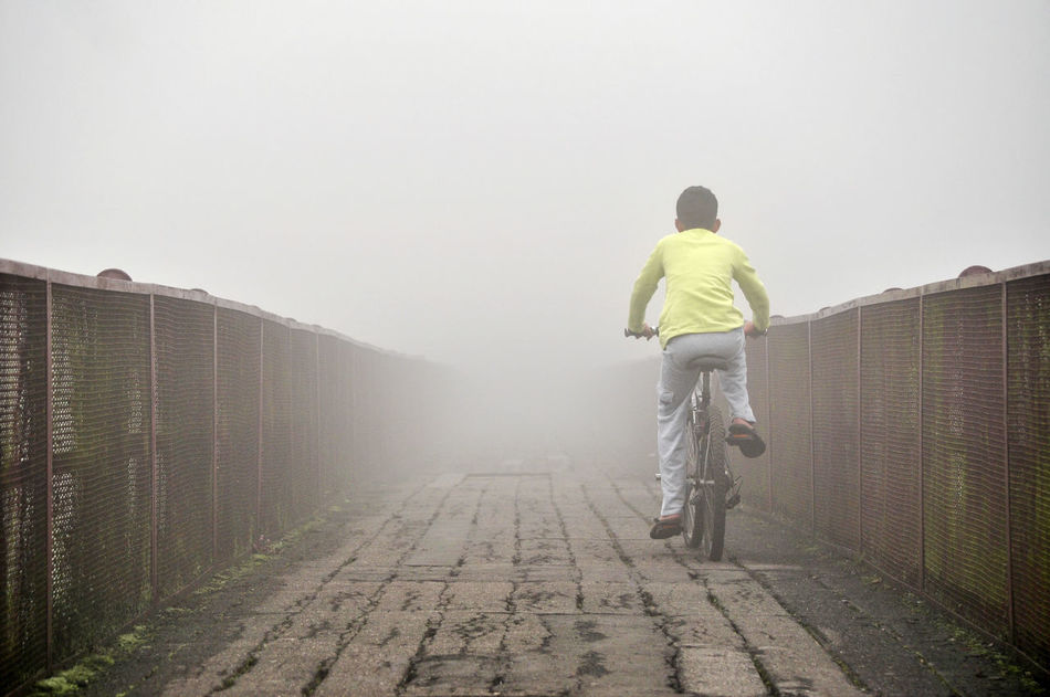 Unknown Destination Bicycle Bike Boy Casual Clothing Cycling EyeEm Best Shots EyeEm New Here Fog Foggy Having Fun Kid Leisure Activity Mist Misty One Boy Outdoors Perspective Rear View Riding Riding Bike The Secret Spaces The Way Forward Unrecognizable Person Break The Mold TCPM