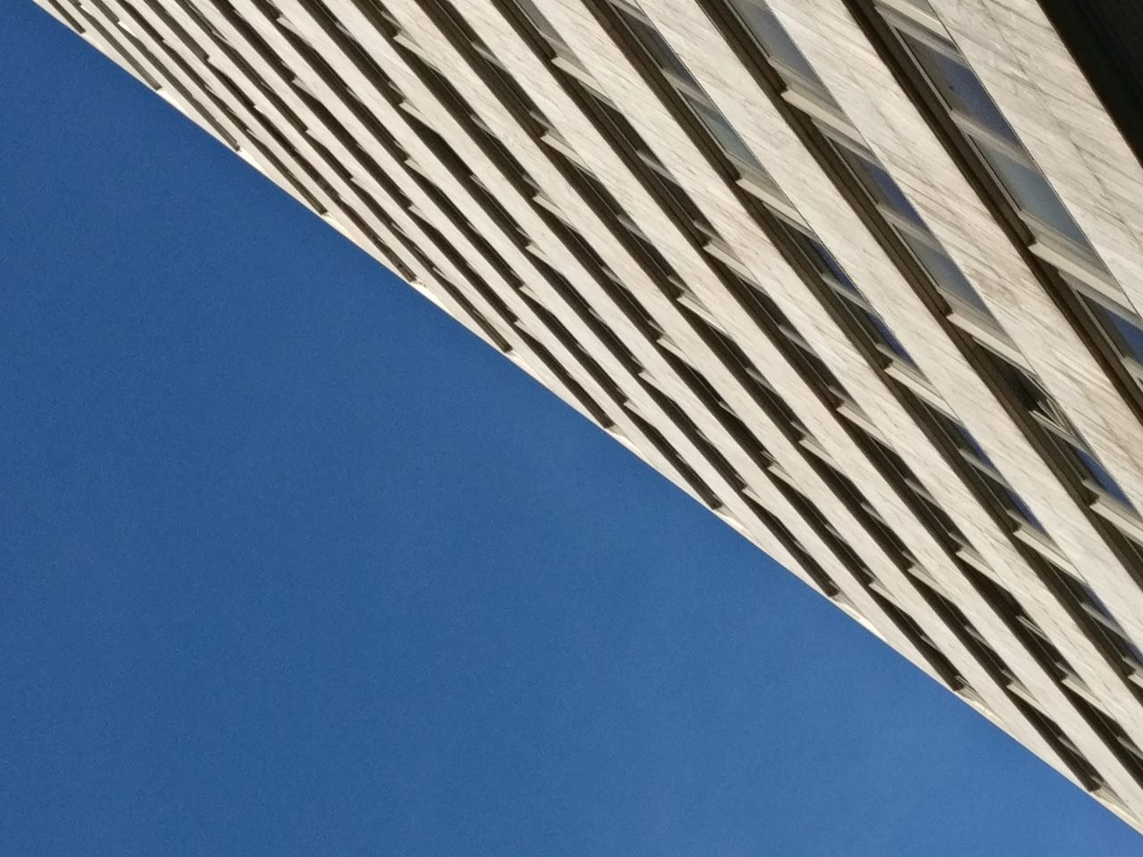 low angle view, architecture, blue, building exterior, built structure, pattern, clear sky, day, outdoors, no people, modern, close-up, sky