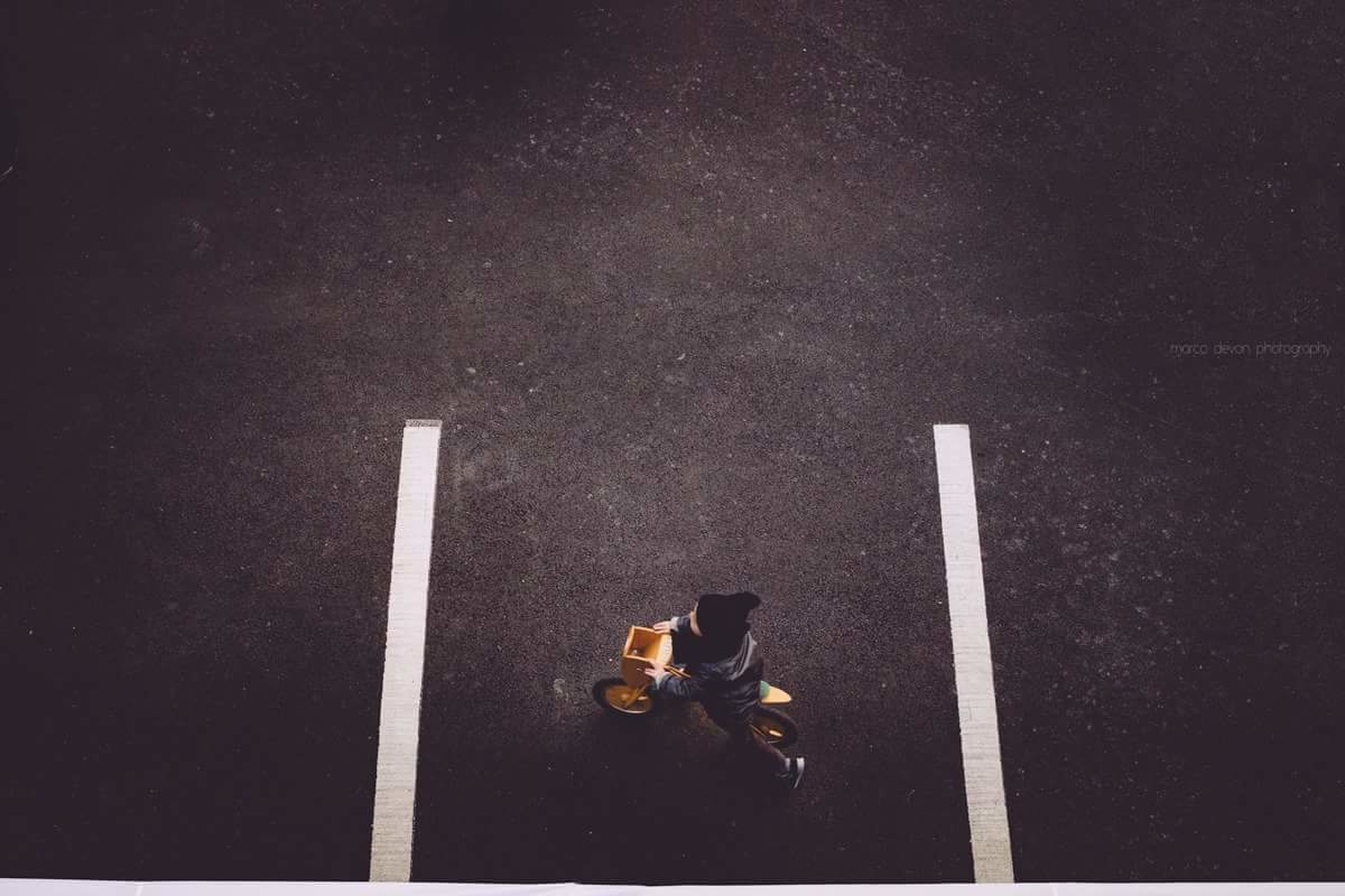 high angle view, street, road, transportation, asphalt, road marking, night, shoe, outdoors, men, shadow, standing, footwear, unrecognizable person, auto post production filter, copy space, directly above