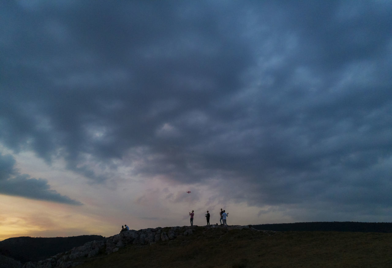 playing with a drone at sunset Cloud - Sky Drone  Landscape Leisure Activity Nature Outdoors People Shillouette Sky Storm Cloud Sunset