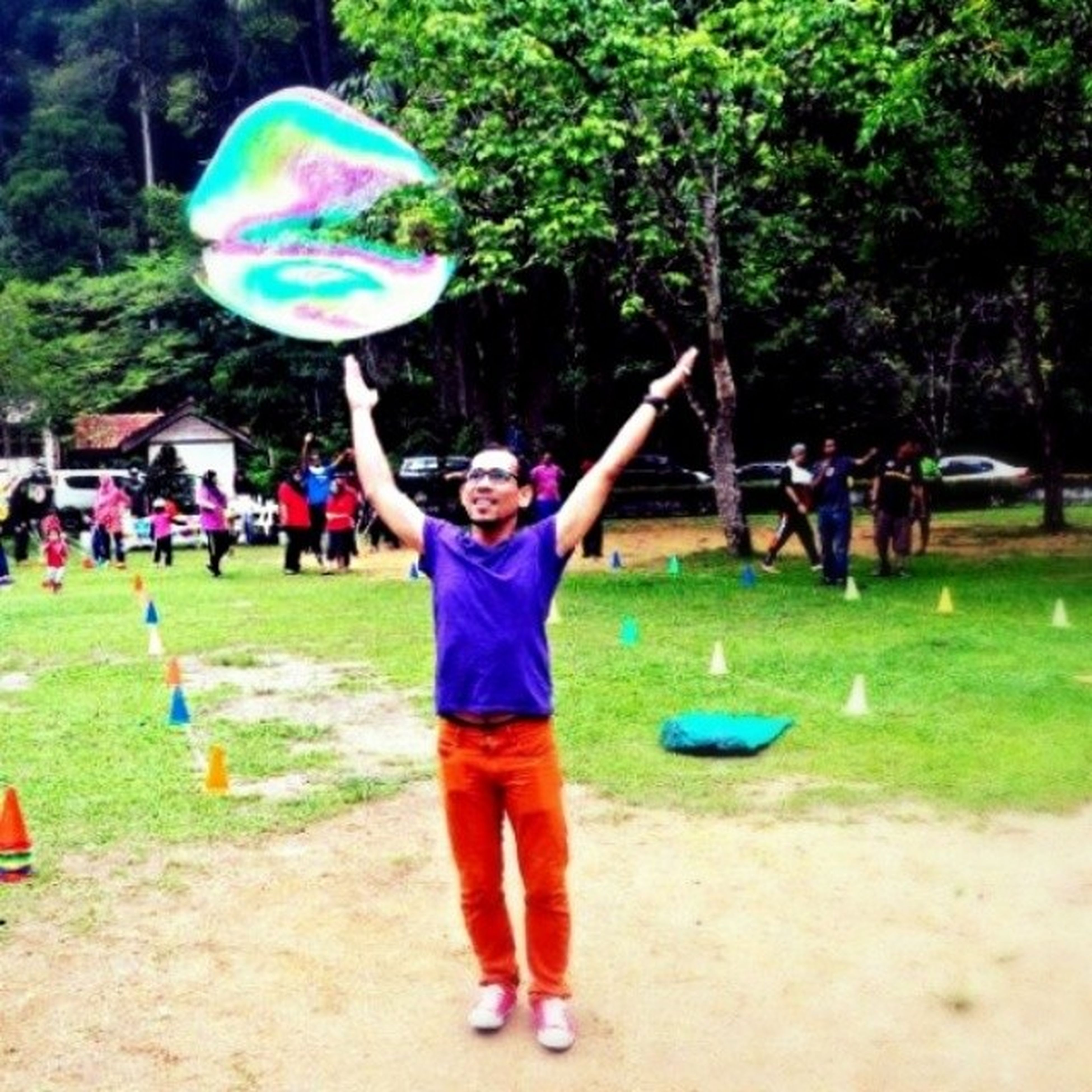 leisure activity, lifestyles, enjoyment, fun, playing, childhood, girls, full length, bubble, tree, grass, mid-air, boys, playful, casual clothing, elementary age, park - man made space, motion
