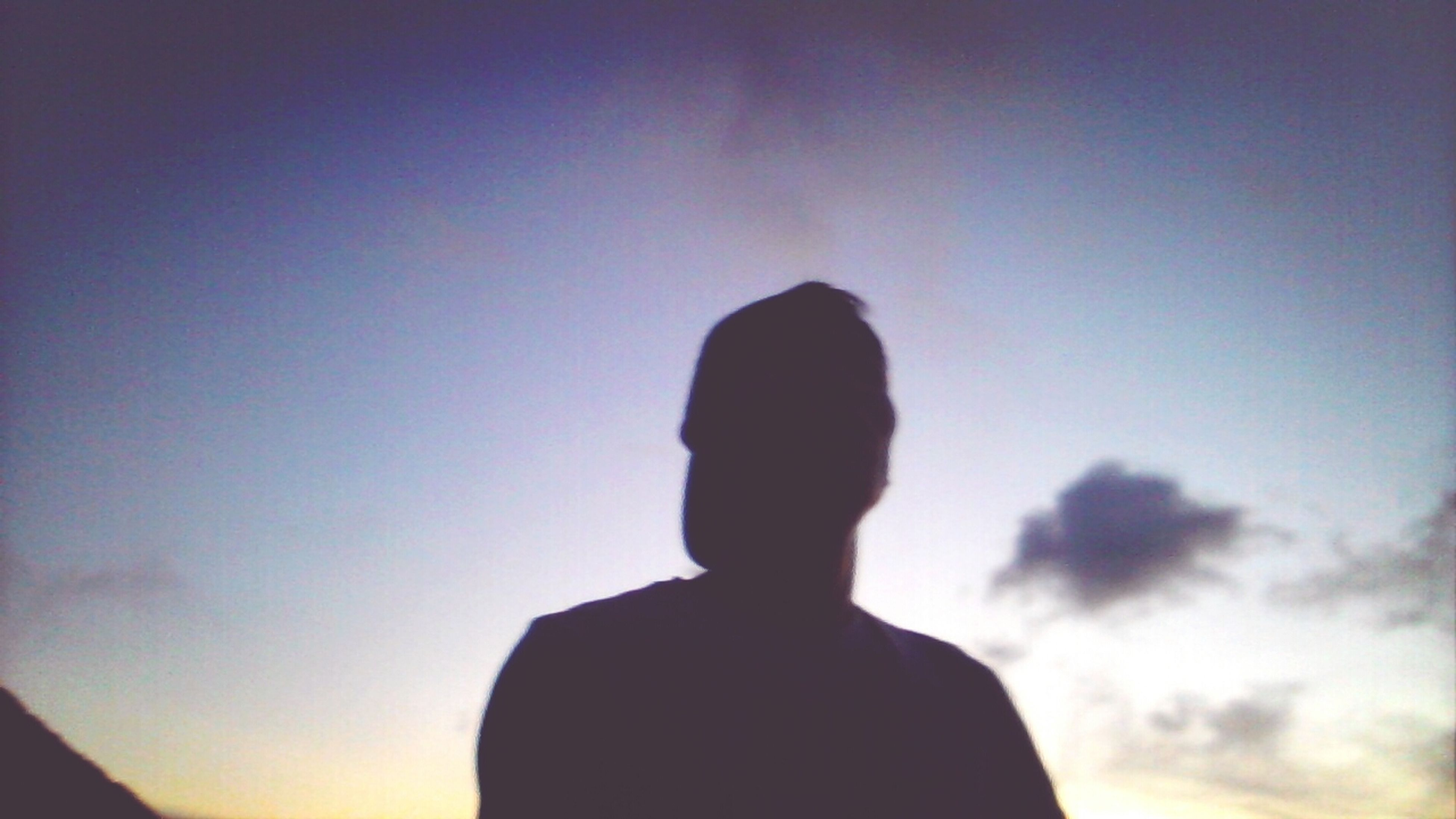 silhouette, lifestyles, rear view, standing, waist up, sky, leisure activity, headshot, sunset, copy space, men, low angle view, three quarter length, outline, person, dusk, back lit, unrecognizable person