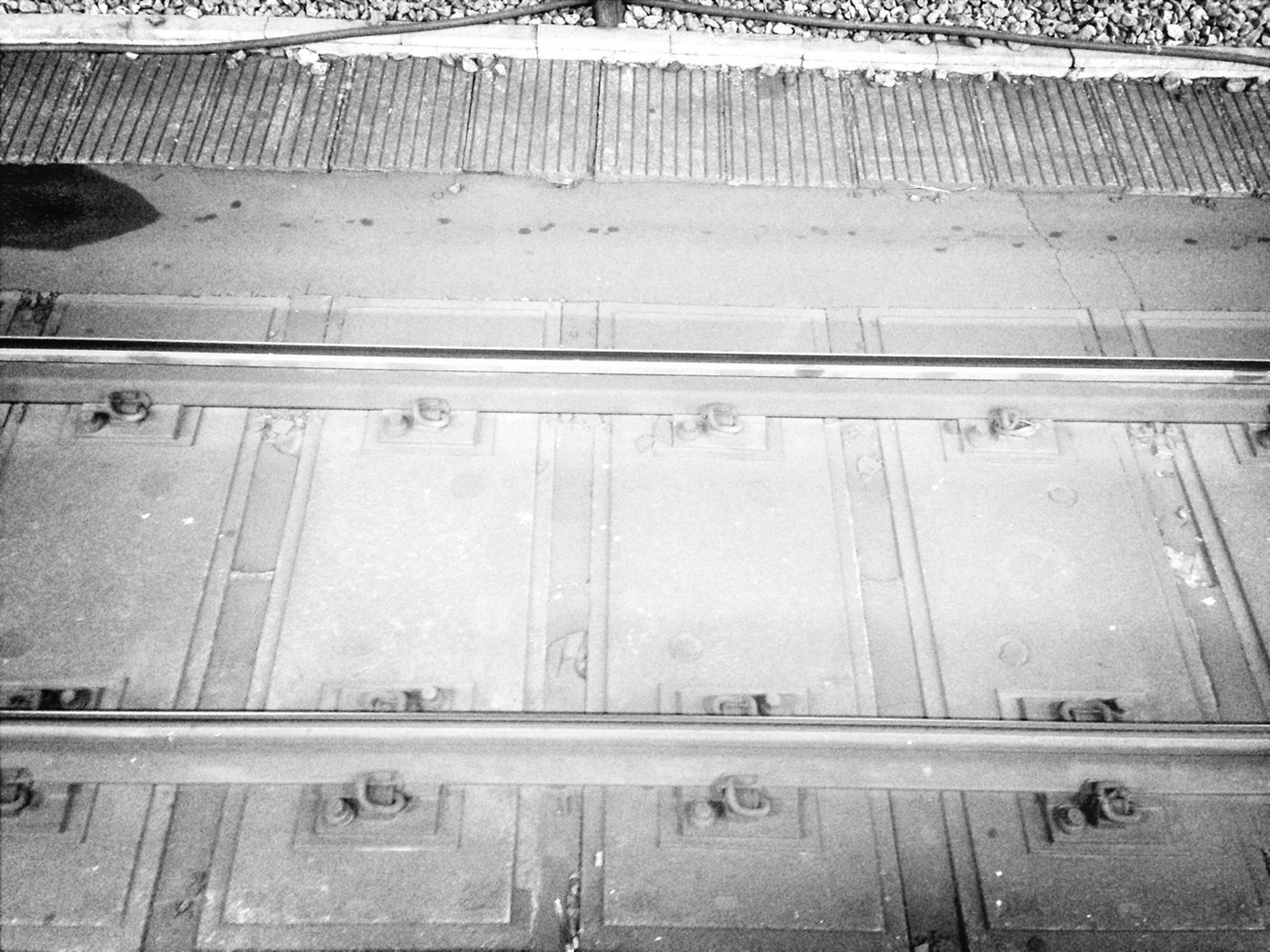 transportation, high angle view, indoors, wet, mode of transport, water, day, public transportation, road, full frame, street, travel, rail transportation, land vehicle, reflection, backgrounds, no people, metal, glass - material