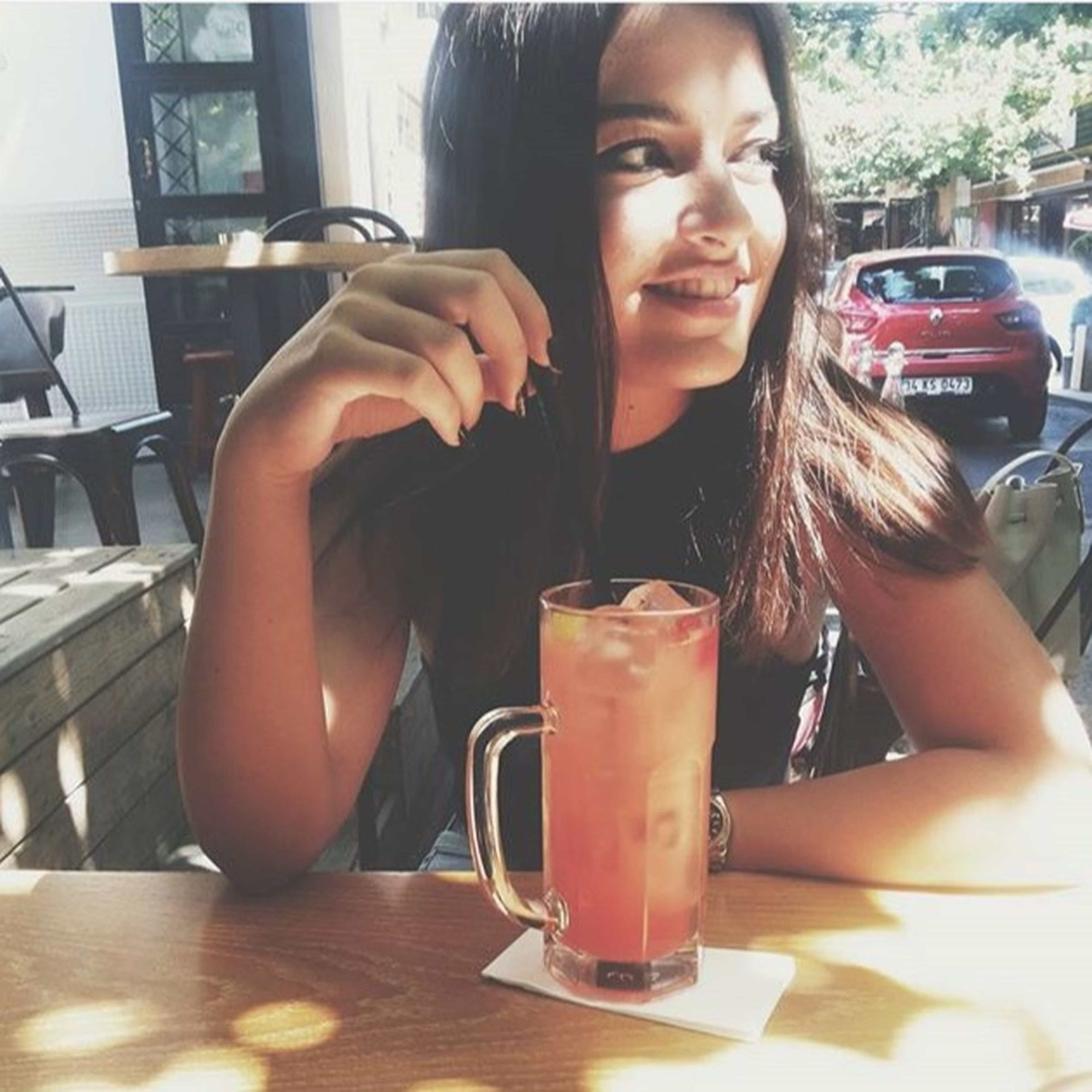 food and drink, lifestyles, drink, person, leisure activity, holding, young adult, refreshment, freshness, food, front view, table, indoors, casual clothing, sitting, looking at camera, portrait, young women