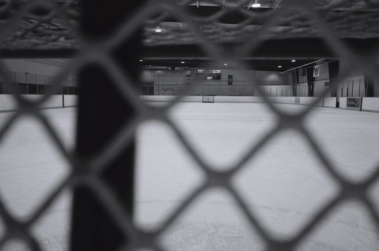 from behind the hockey net Blackandwhite Monochrome Contrast Ricoh Gr Hockey Arena Chainlink Fence Sport Sports Venue Soccer Built Structure No People Competition Day Stadium
