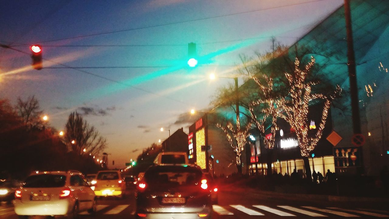 Capture The Moment Beautiful Sunset Discovering EyeEm Learning To Edit Christmas Shopping Crowd Cars Night Illuminated Transportation Car Street City Mode Of Transport Road Outdoors No People Sky 2016