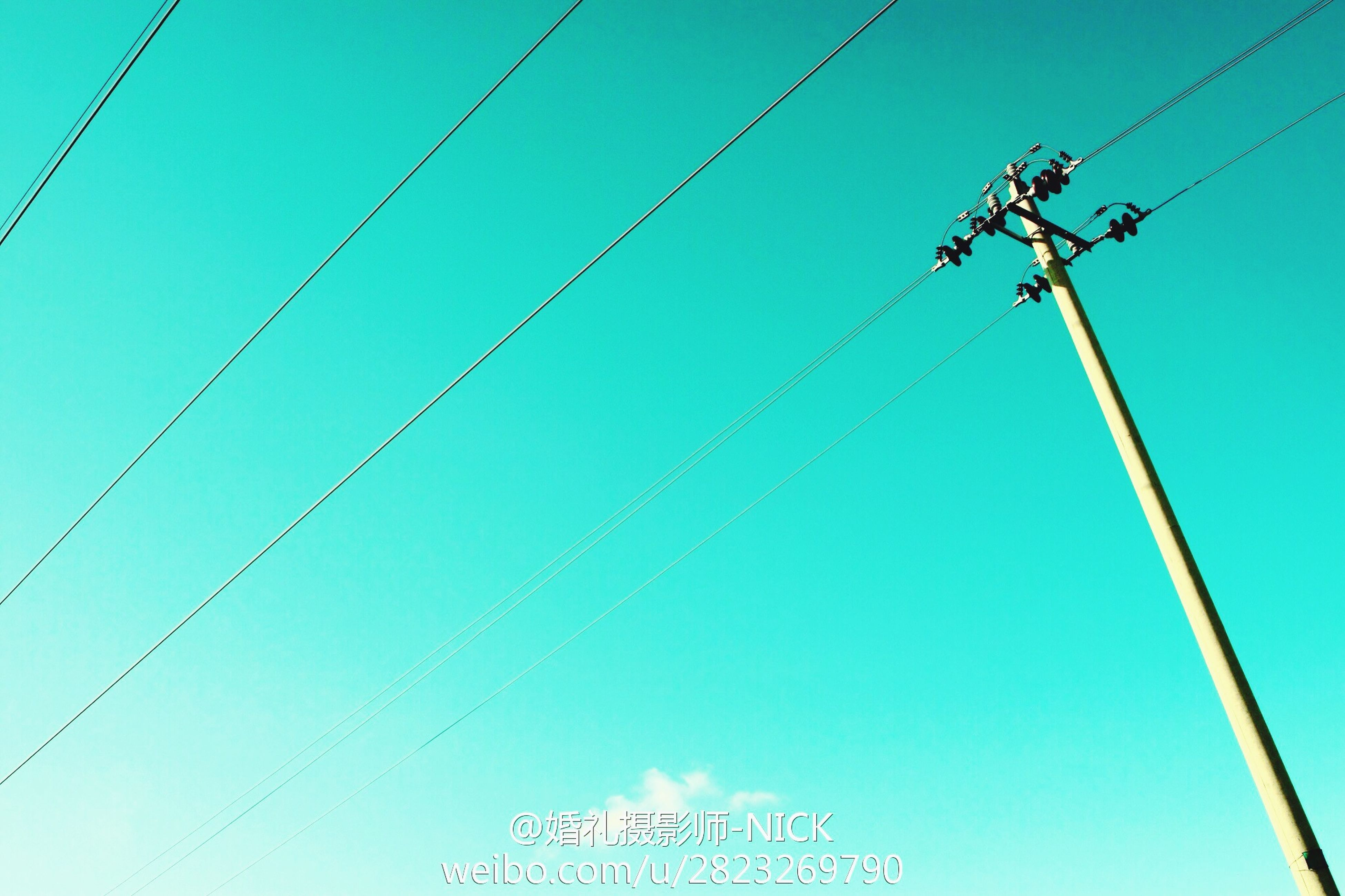low angle view, cable, power line, connection, clear sky, power supply, electricity, blue, electricity pylon, technology, complexity, rope, power cable, copy space, day, outdoors, no people, transportation, fuel and power generation, pole