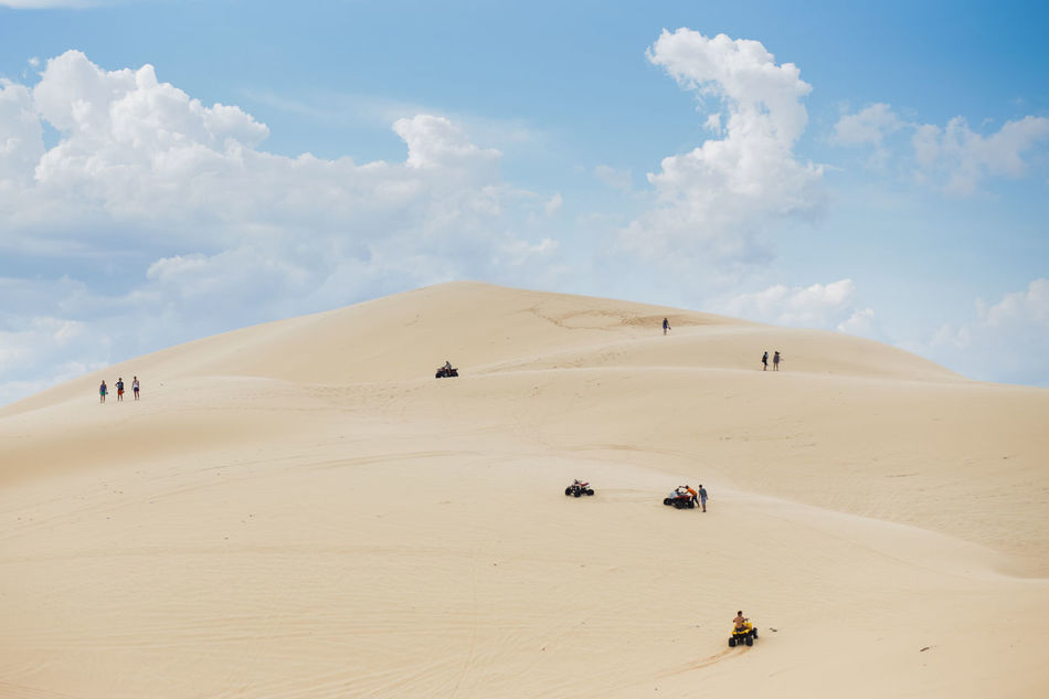 White Sand Dunes, Mui Ne, located in the south of Vietnam. It's about 5-hour away from Ho Chi Minh City. Adventure Arid Climate Beauty In Nature Cloud - Sky Desert Landscape Leisure Activity Lifestyles Muine Muine, Vietnam  Nature Outdoors Physical Geography Sand Sand Dune Sky Travel Destinations White Sand Dunes Break The Mold