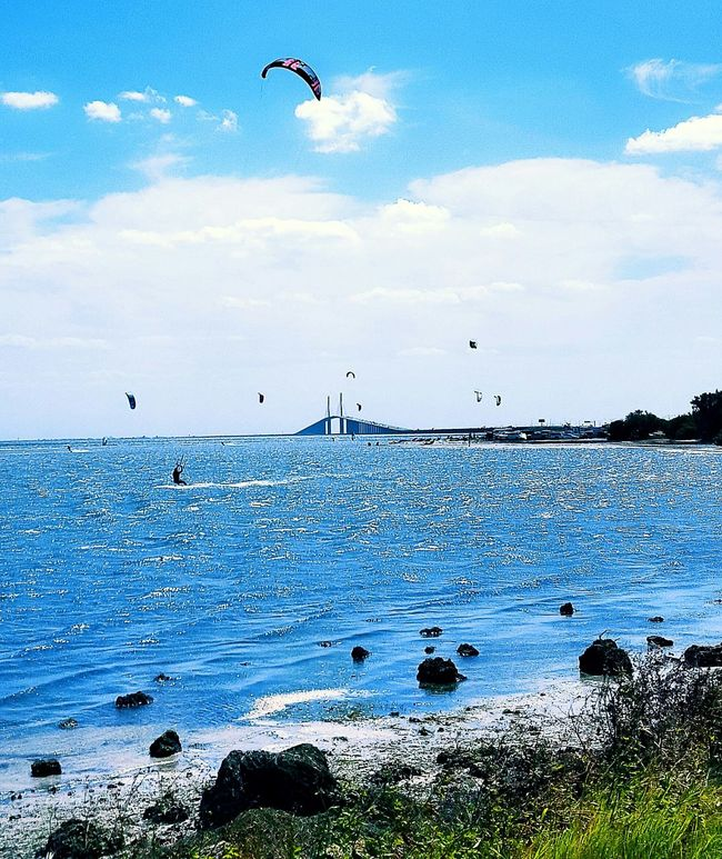 Another shot of the Sunshine Skyway Bridge and all the kiteboarders out in this windy Monday afternoon!!! Bridge Ocean Gulf Of Mexico Kiteboarding Watersports Landscape Clouds And Sky Rocks Florida Life Enjoying Life Blue Wave
