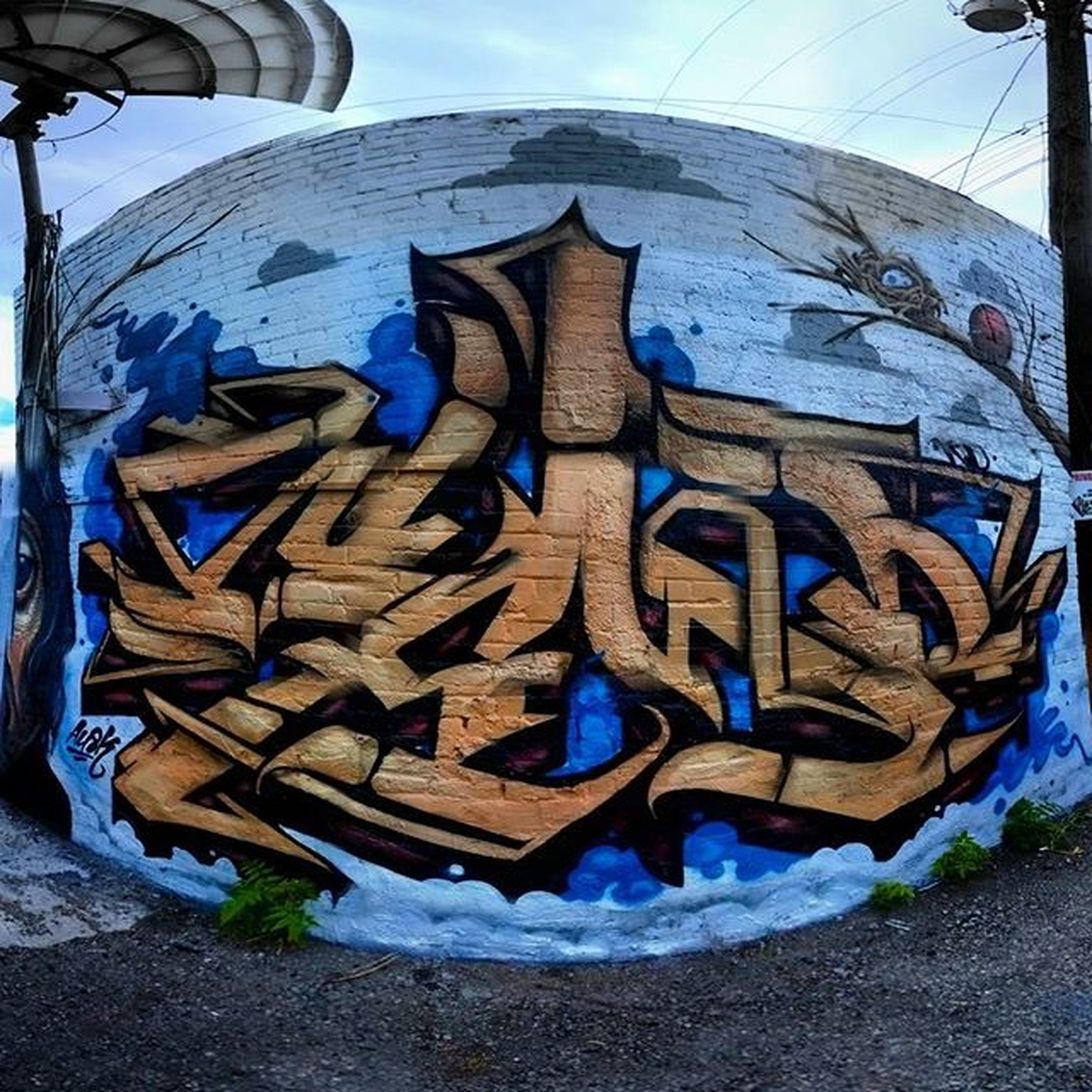 blue, built structure, building exterior, architecture, sky, day, outdoors, sunlight, graffiti, no people, art and craft, close-up, art, creativity, wall - building feature, old, reflection, abandoned, multi colored, damaged