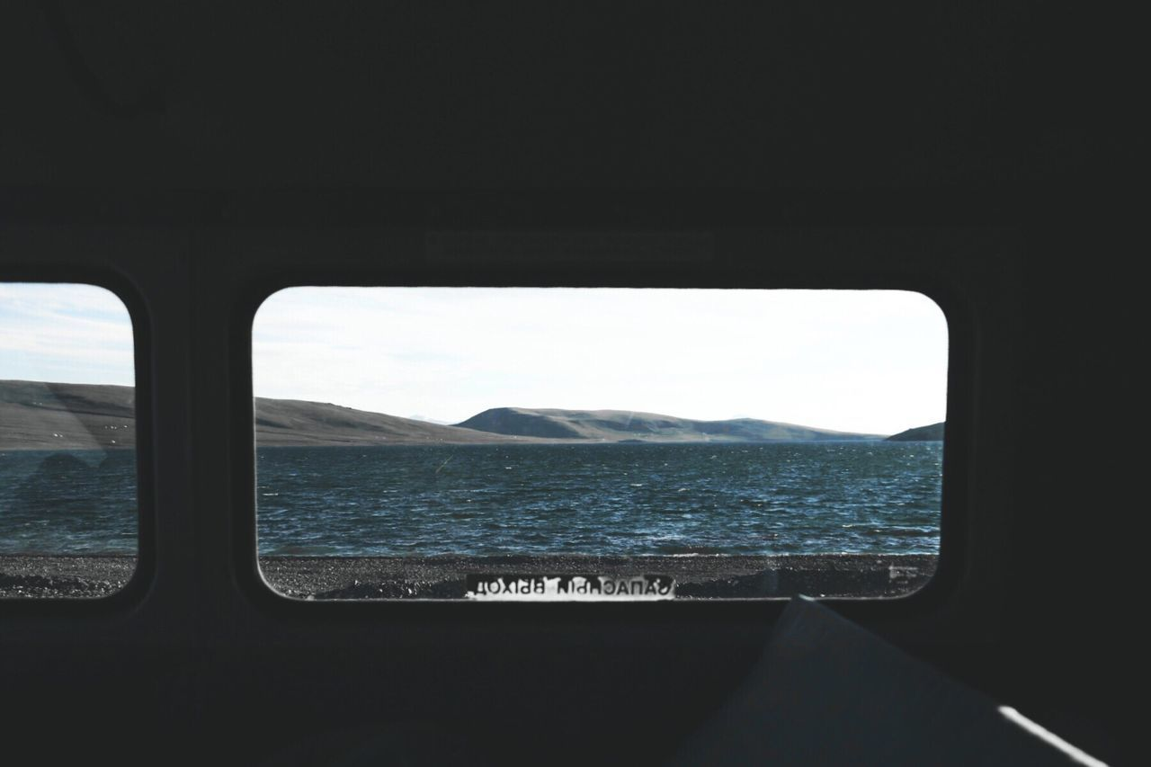 vehicle interior Transportation window mode of transport mountain Travel sea journey scenics day Nature sky landscape air vehicle no people airplane water beauty in Nature mountain range nautical vessel light and shadow Taking Photos Check this out Travel outdoors