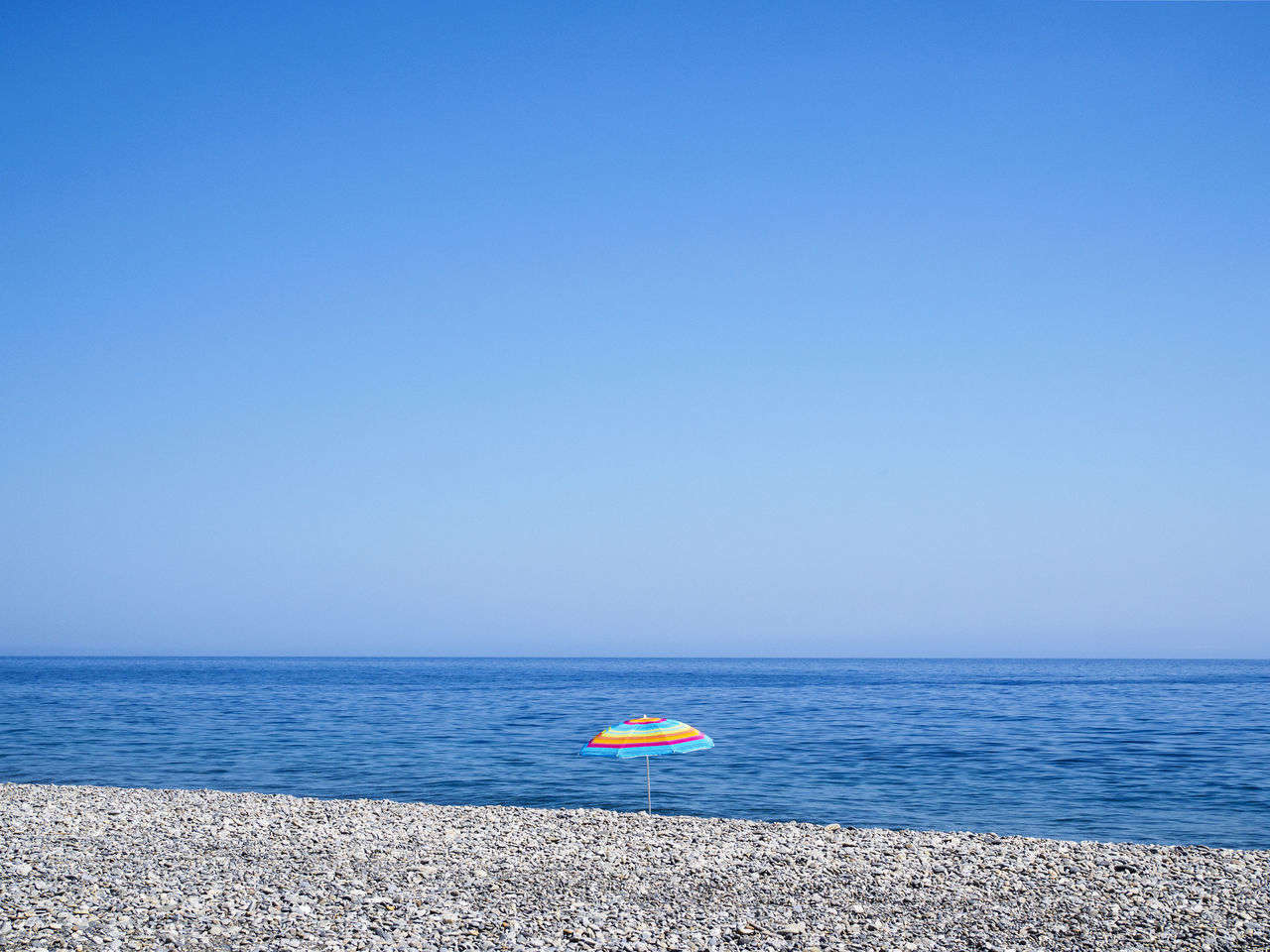 Sougia beach on the south side of Crete Beach Blue Clear Sky Holiday Horizon Over Water Minimalism No People Pebble Beach Sea Summer Tranquil Scene Tranquility Umbrella Vacations Water