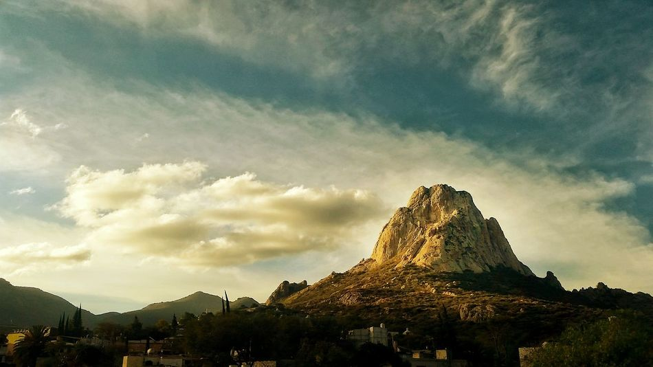 "The great ""Peña de Bernal"" in Querétaro, Mexico, third largest monolith in the world! Travel Destinations Tourism Landscape Cloud - Sky Mountain Portrait Relaxation Silhouette Illuminated EyeEm Masterclass Colors Of Autumn Eyem Best Shots Girl Cdmx2016 Girls Silouette & Sky Today's Hot Look That's Me First Eyeem Photo EyeEm Best Shots EyeEm Gallery Colors Of Nature Eyeemphoto Faces Of EyeEm People Watching"