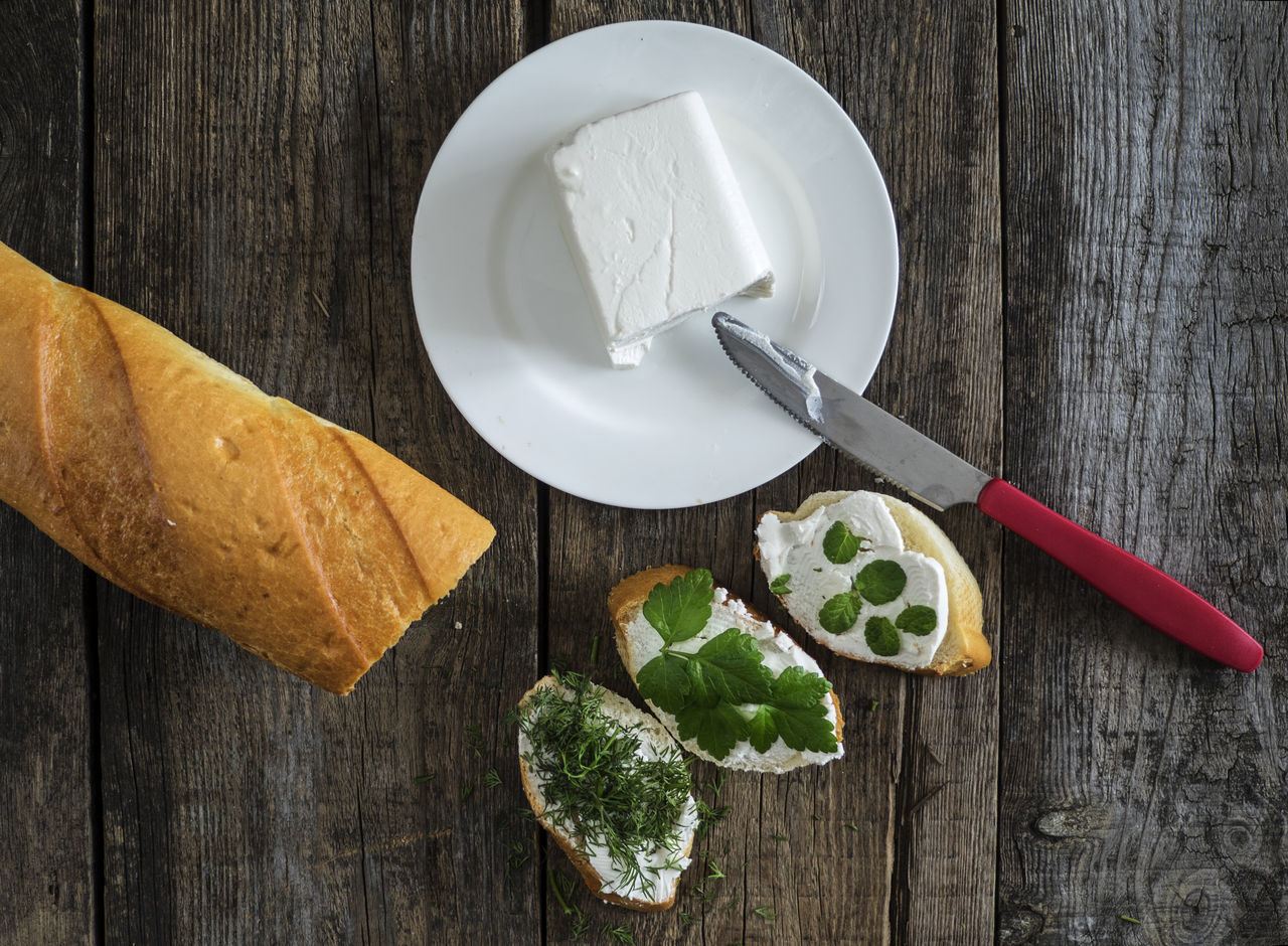 bruschetta with feta cheese and chopped spicy herbs on an old wooden weathered table Background Bread Bruschetta Cheese Chopped Close-up Dessert Feta Food Freshness Herbs Low Carb Diet Meal No People Old Planks Spicy Sweet Food Table Weathered Wood - Material Wooden