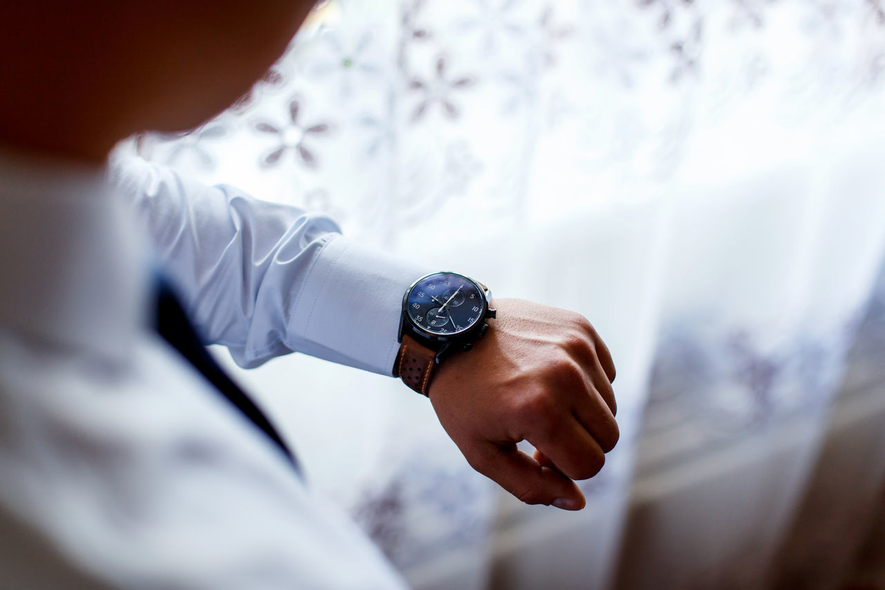 Watch on man's hand. a man watching time Adult Business Businessman Clock Close-up Day Human Body Part Human Hand Indoors  Men One Man Only One Person People Real People Time Watch Wedding Working Wristwatch Young Adult