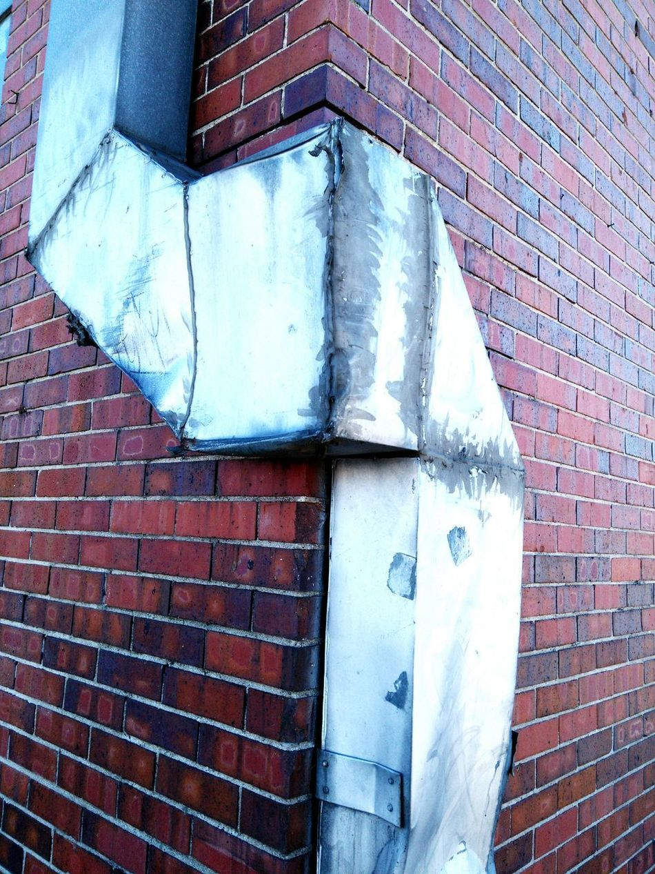 Built Structure Brick Wall Building Exterior Architecture No People Outdoors Close-up Day Backgrounds Metal Metal Industry Metallic Metal Structure Metalic Metalwork Brick Wall Brick Brick Building Brickporn Brickwall Corner Corner Building Corners Masculine