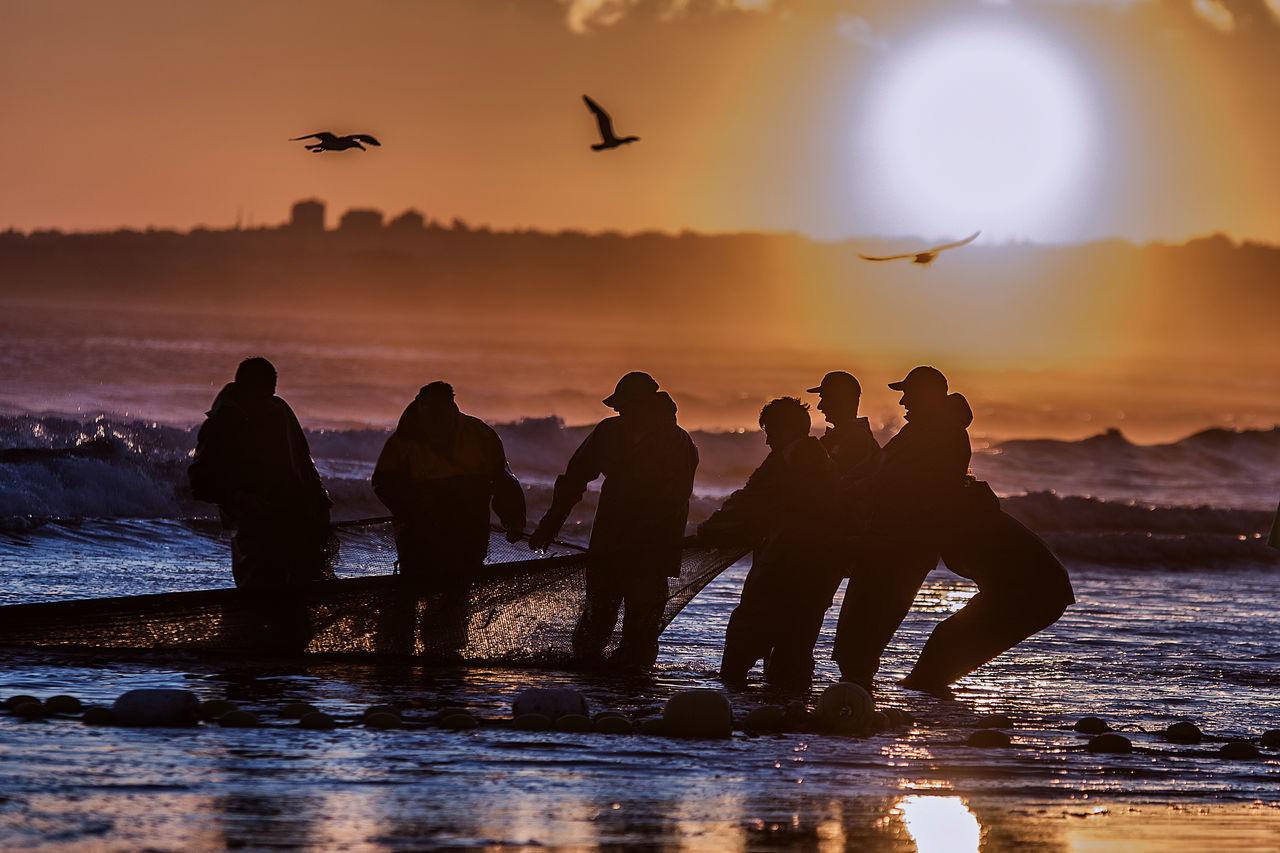 Beautiful stock photos of sunset, Costa De Caparica, Effort, Fisherman, Fishermen