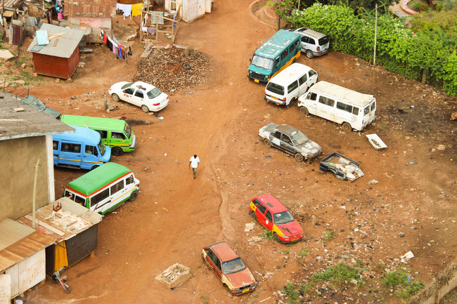 Wonderful colors of Africa! in Accra, Ghana Africa Car Colors Day Dirty Eye4photography  EyeEm Best Shots From Above  High Angle View Land Vehicle Man Mode Of Transport On The Move Parking Red Road Road Marking Sand Starting A Trip Street Transportation Travel Travel Traveling Arial Shot