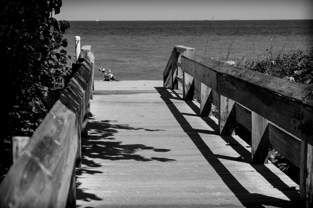 Love is a Beach Architecture Beach Beach Life Beach Photography Beauty In Nature Blackandwhite Photography Built Structure Day Florida Fujifilm_xseries Horizon Over Water Life Is A Beach Light And Shadow Nature Outdoors Photographyisthemuse Railing Scenics Sea Seascape Sky Tranquil Scene Tranquility Water