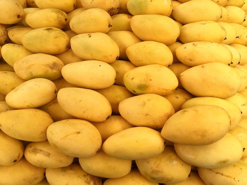 Ripe mangoes for sale at a stall in Manila. Food Freshness Food And Drink Large Group Of Objects Yellow Full Frame For Sale Market Backgrounds Market Stall No People Fruits Mango Mangoes Ripe Mangoes Philippines Manila Food Stories