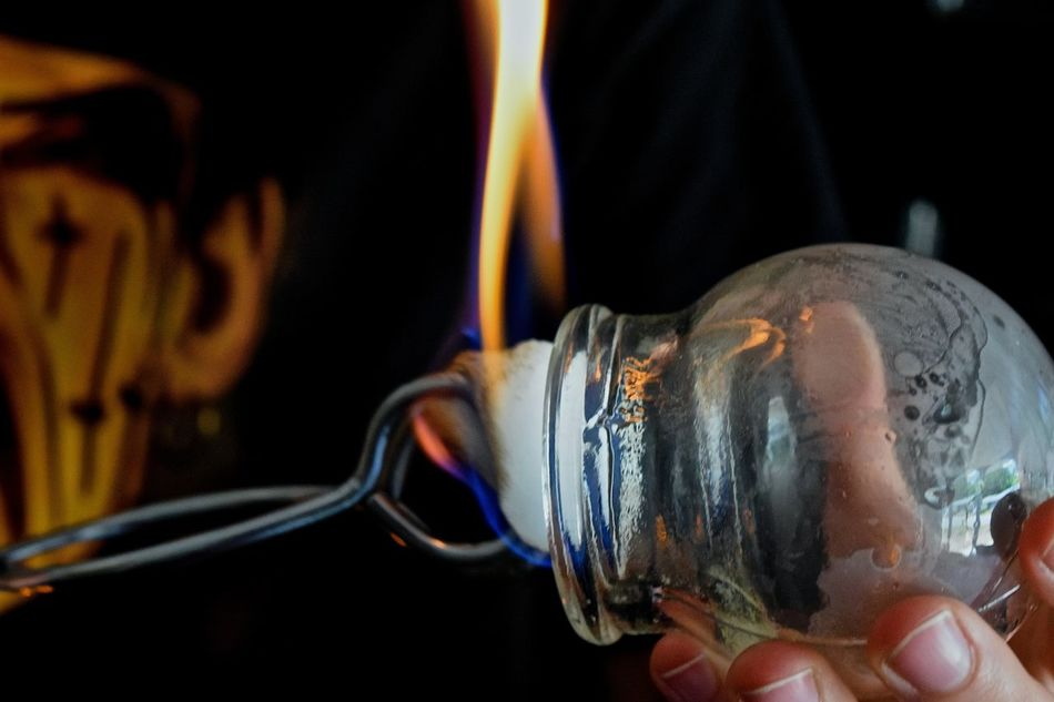 Warming up Massage Glass Cups in Tampa, FL Close-up Cups Flame Focus On Foreground Heat Massage Cupping Massage Cups Part Of