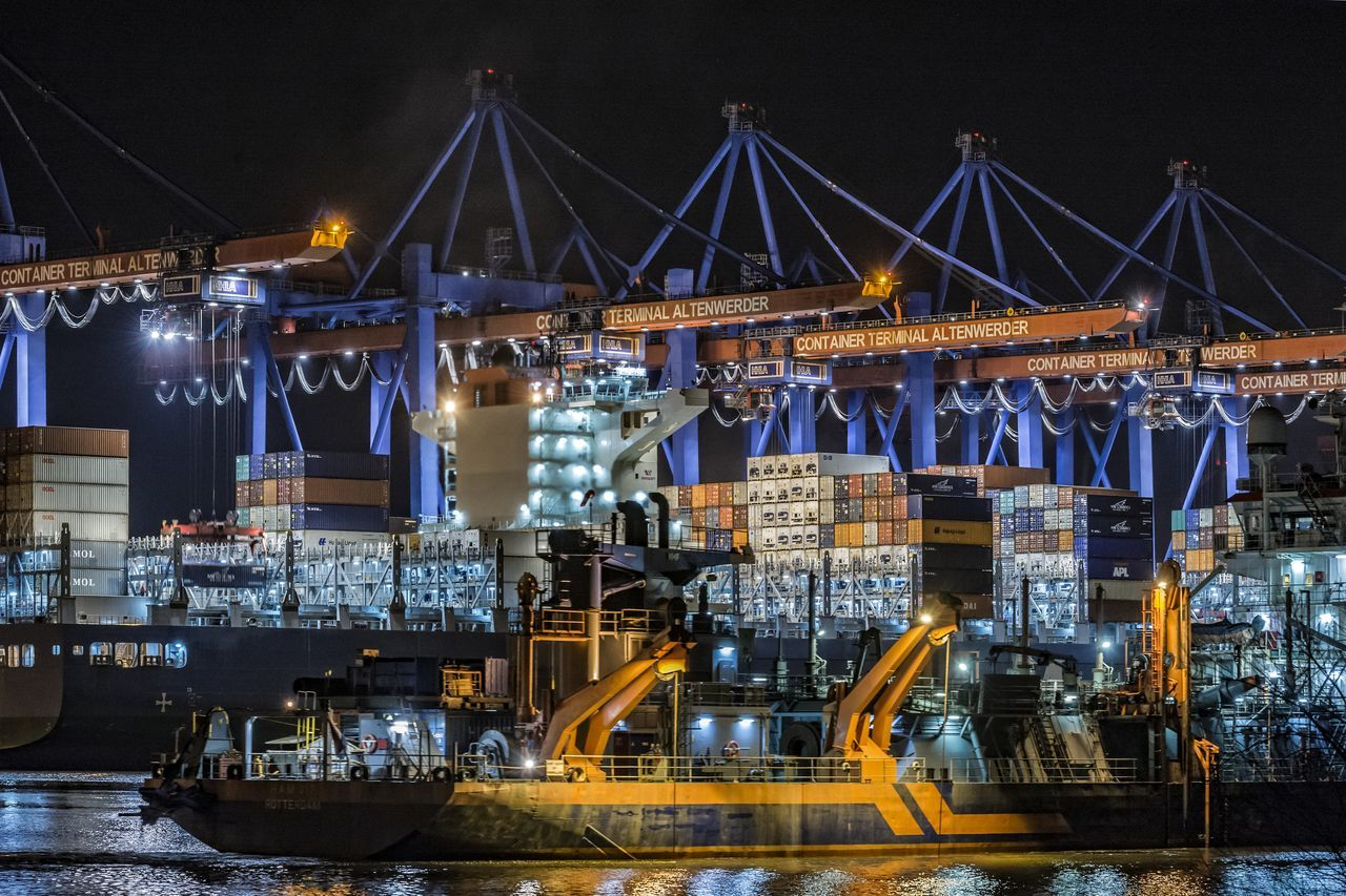illuminated, night, freight transportation, industry, shipping, crane - construction machinery, transportation, commercial dock, architecture, water, built structure, no people, factory, harbor, nautical vessel, outdoors, manufacturing equipment
