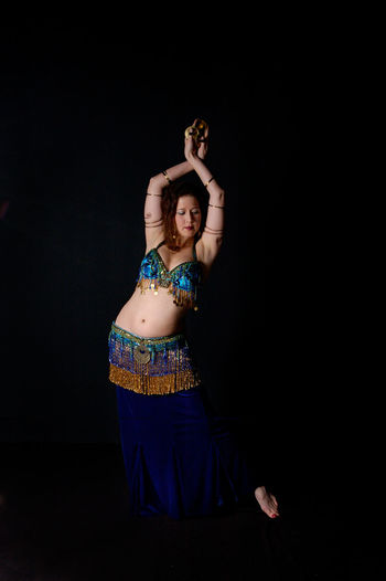 Belly Dance Belly Dancer Dance Arms Raised Beautiful Woman Belly Dancer Belly Dancing Bellydance Bellydancer Bellydancing Black Background Celebration Color Cultures Dancer Full Length Happiness Human Arm One Person One Woman Only People Standing Studio Shot Traditional Clothing Young Women