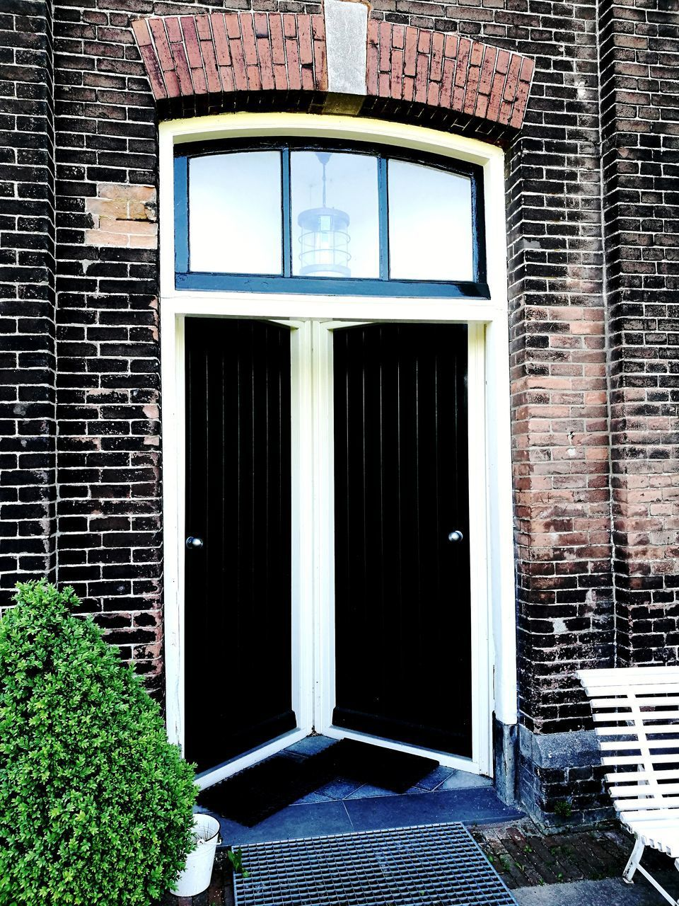 architecture, built structure, building exterior, door, window, outdoors, brick wall, no people, day