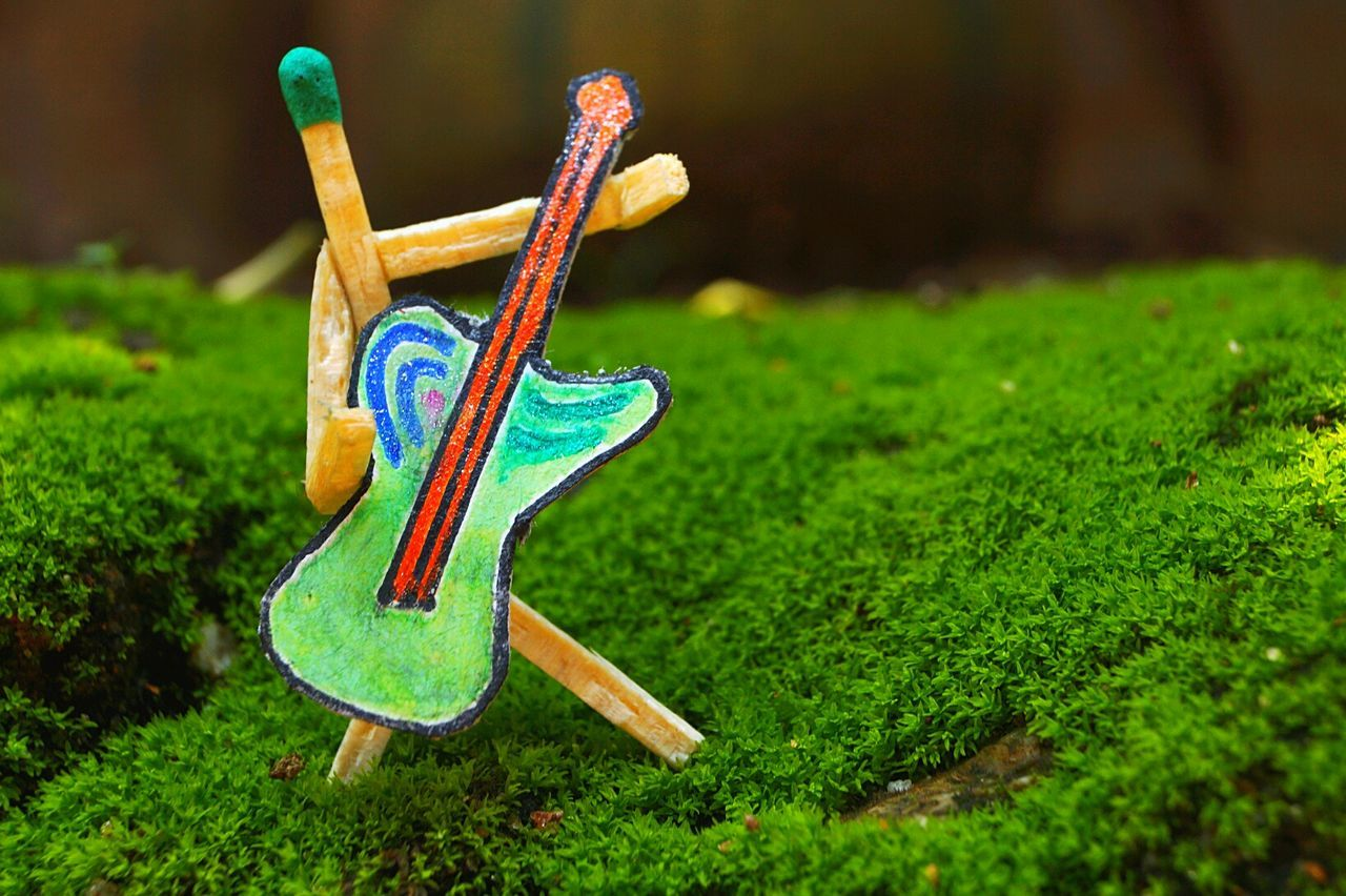 Creative shot Creative Shots Guiter Match Stick Match Stick Man Man Creative Photography No People Outdoors Green Background Day Day Light Multi Colored Close-up Bright Colors in Guwahati Assam, India Art Is Everywhere Break The Mold