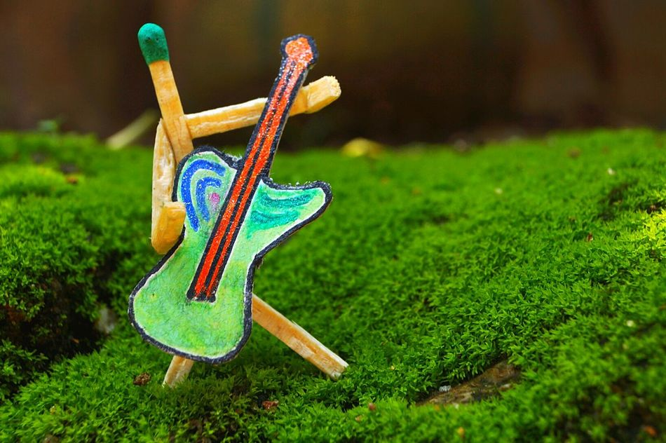 Creative shot Creative Shots Guiter Match Stick Match Stick Man Man Creative Photography No People Outdoors Green Background Day Day Light Multi Colored Close-up Bright Colors in Guwahati Assam, India