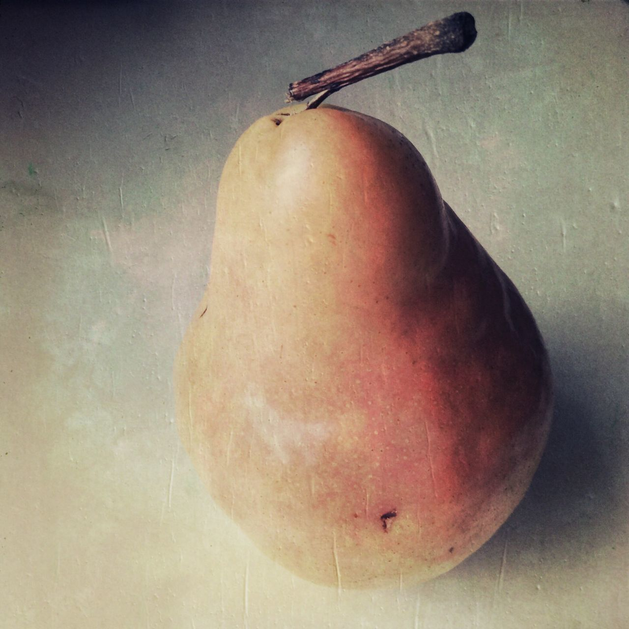 Close-Up Of Pear On Surface