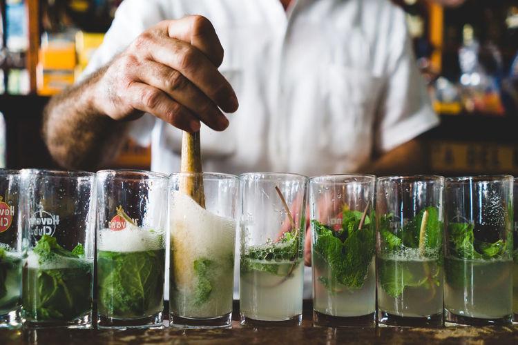 Bartender prepraring mojitos Alcohol Bar Bartender Beverage Bodeguita Del Medio Close-up Cocktail Cuba Cuban Drinks Glass Glasses Havana Indoors  Mint Mojito Preparation  Refreshing Rhum Summer Travel Break The Mold