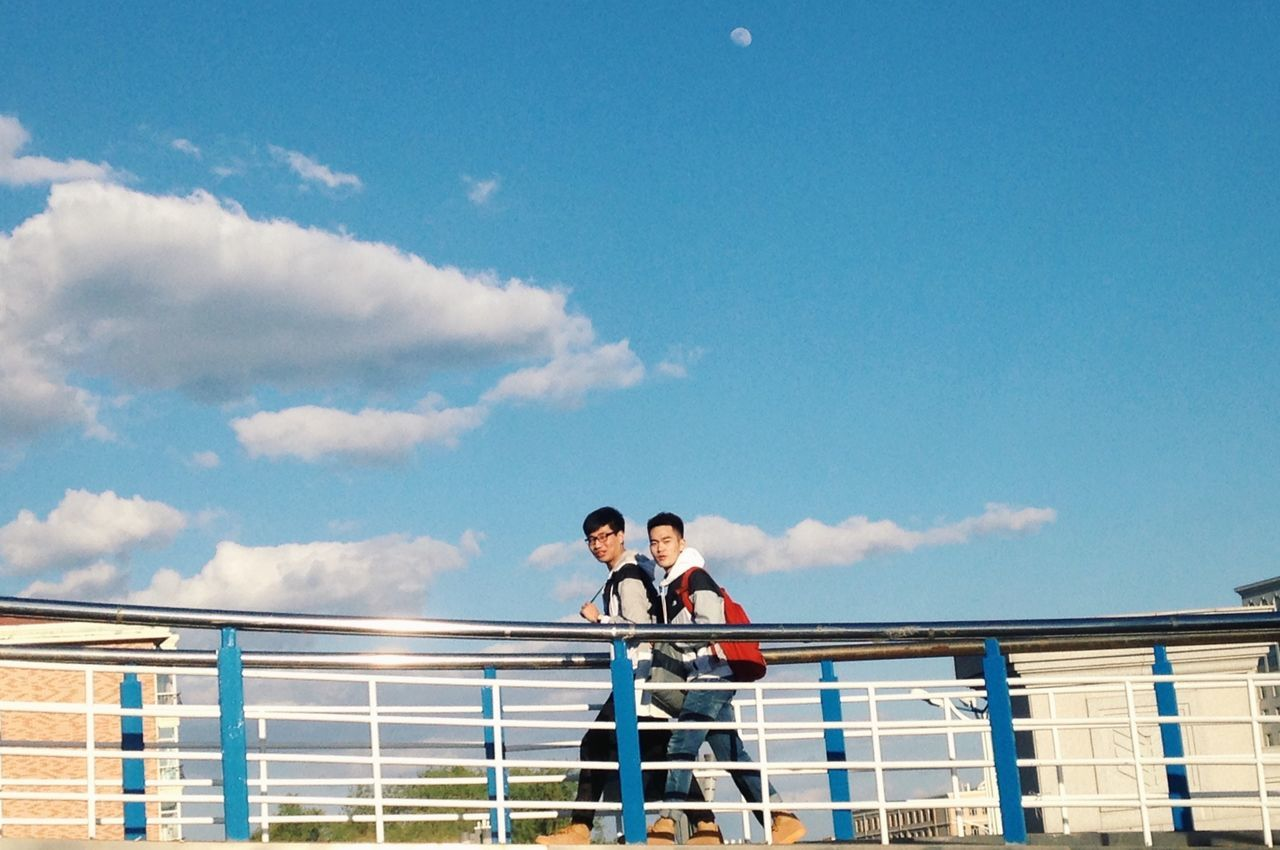 Railing Sky Low Angle View Blue Day Cloud - Sky Outdoors Built Structure Standing Architecture Men Real People Togetherness Young Women Young Adult People BoyLove Boys BoysBoysBoys Bewithyou 你和你的男朋友