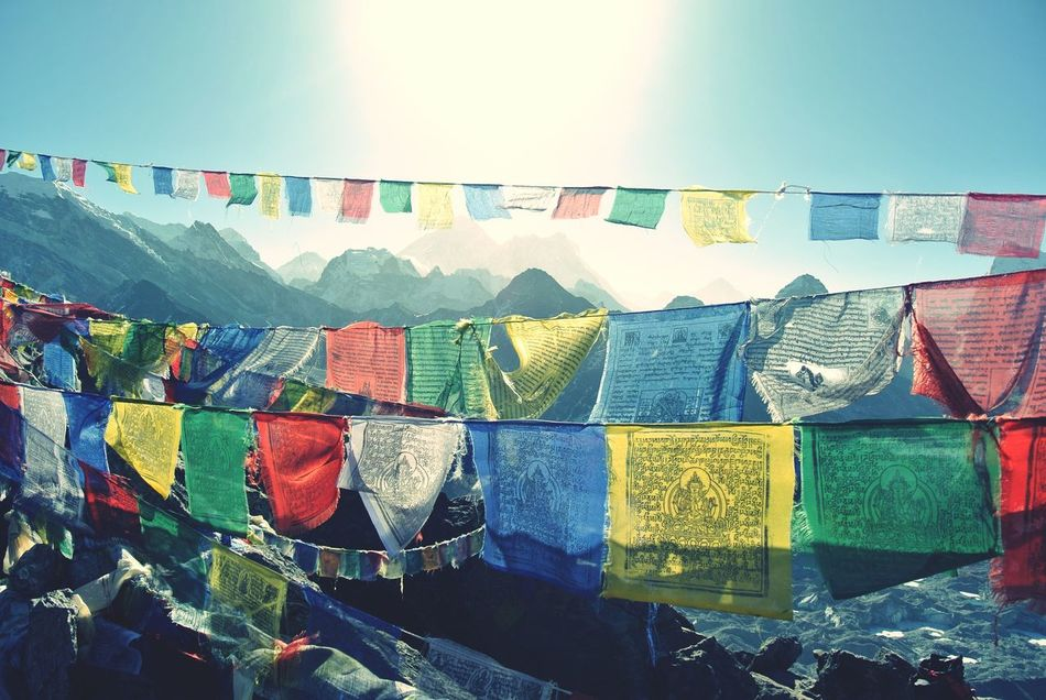 Prayer flags on top of Gokyo Ry Nepal Travel Photography Travel Landscape Adventure Trekking Hikingadventures Mountains And Sky Mountain Range Khumbu Forbidden Places Buddha Dharma Buddhism Buddhist Flag Tibetan Prayer Flags Prayer Flags  Sun Surrealism Colour Of Life Colour Of Life,