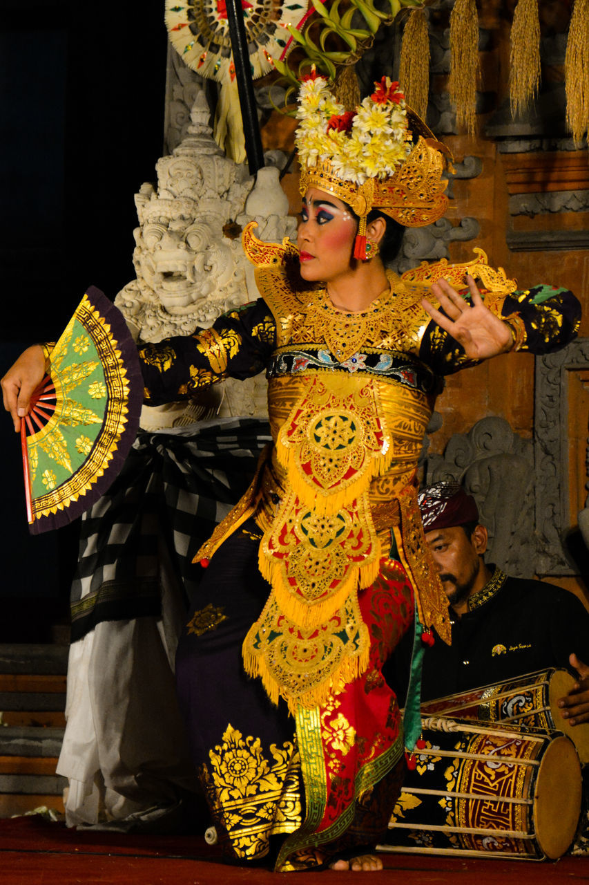 costume, real people, cultures, tradition, traditional clothing, performance, dancer, carnival, indoors, venetian mask, stage costume, performing arts event, headdress, one person, day