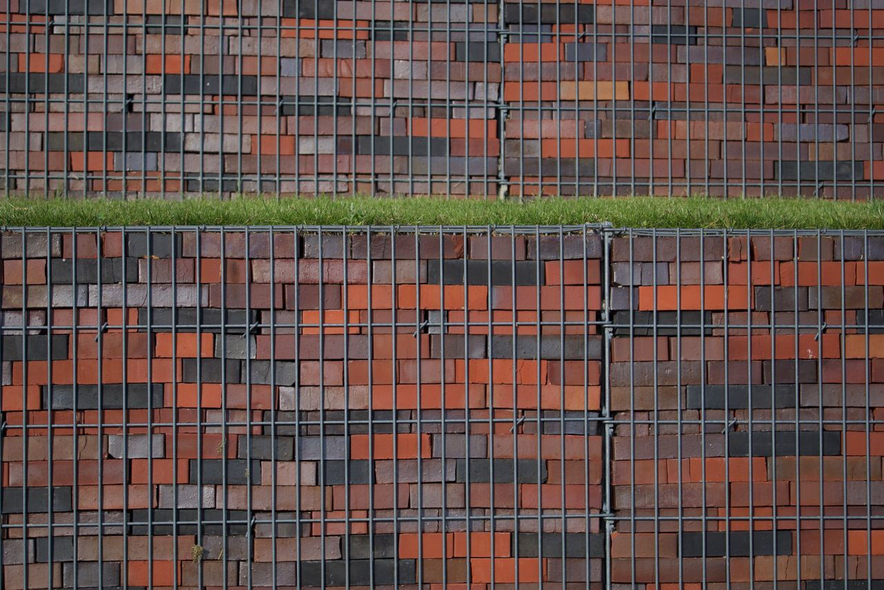 Bricks (Structure) Architecture Bricks Day Fenced In Full Frame Grass No People Outdoors Pattern Textured