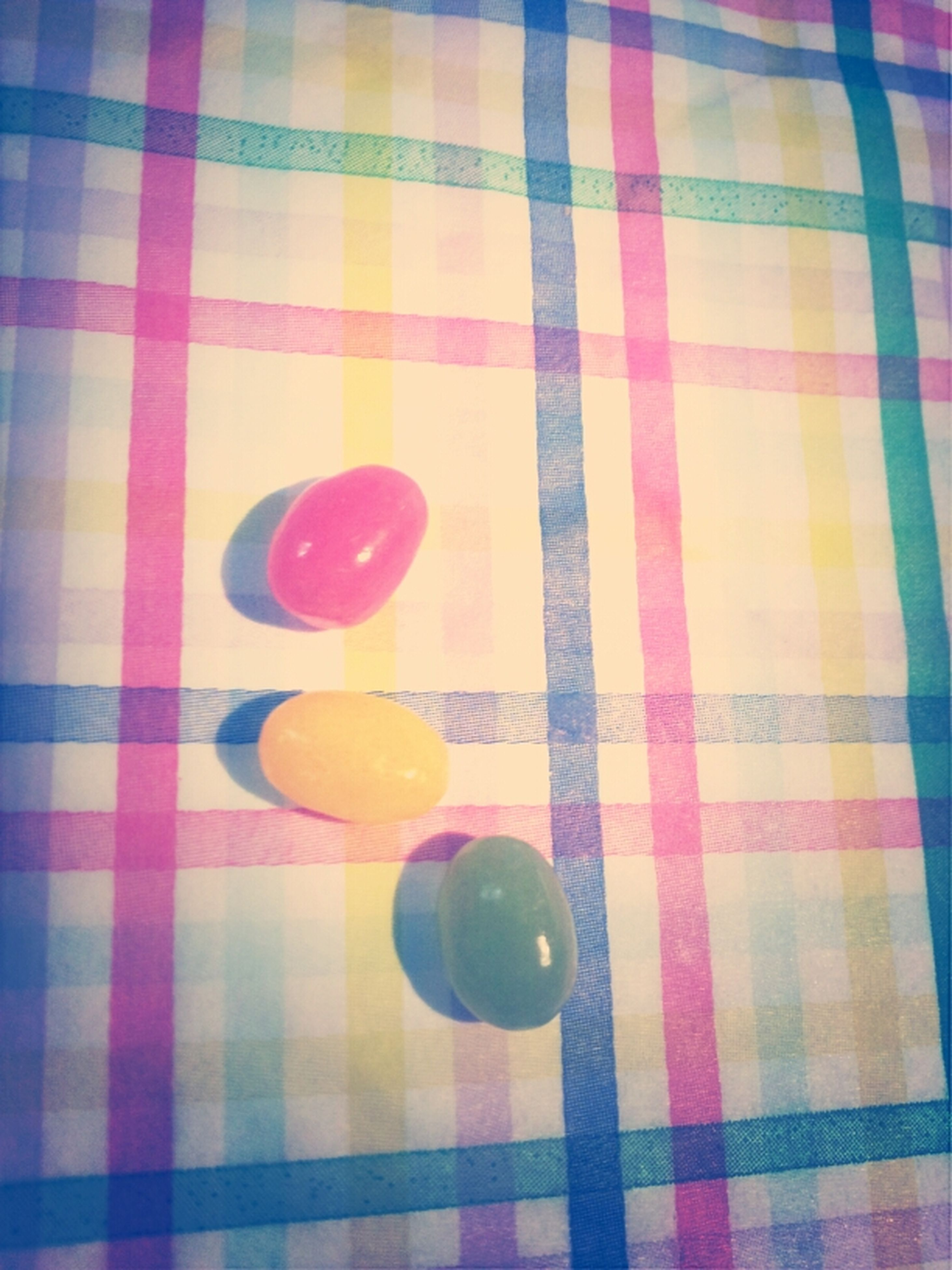 indoors, red, still life, high angle view, table, pattern, multi colored, food and drink, close-up, pink color, directly above, blue, no people, tablecloth, creativity, circle, white color, heart shape, balloon, shape