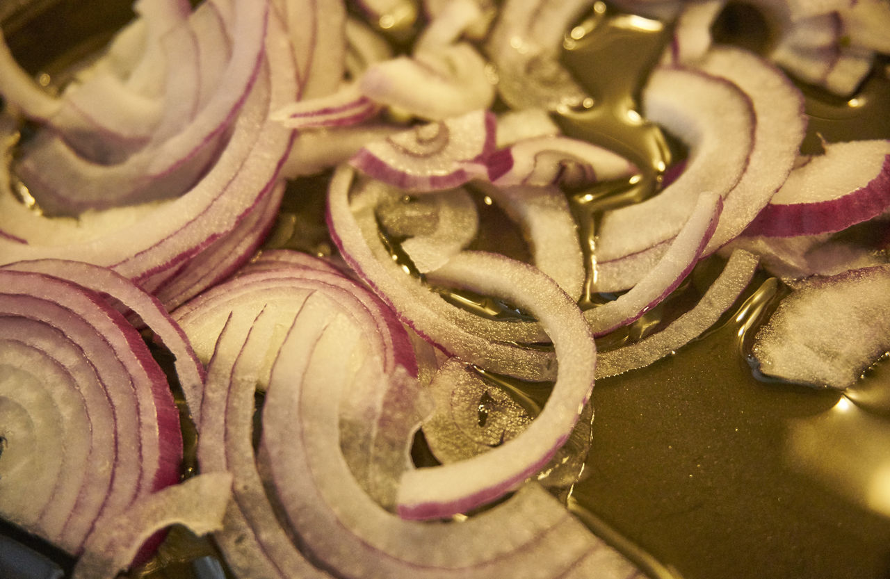 Close-Up Of Chopped Onions In Cooking Pan