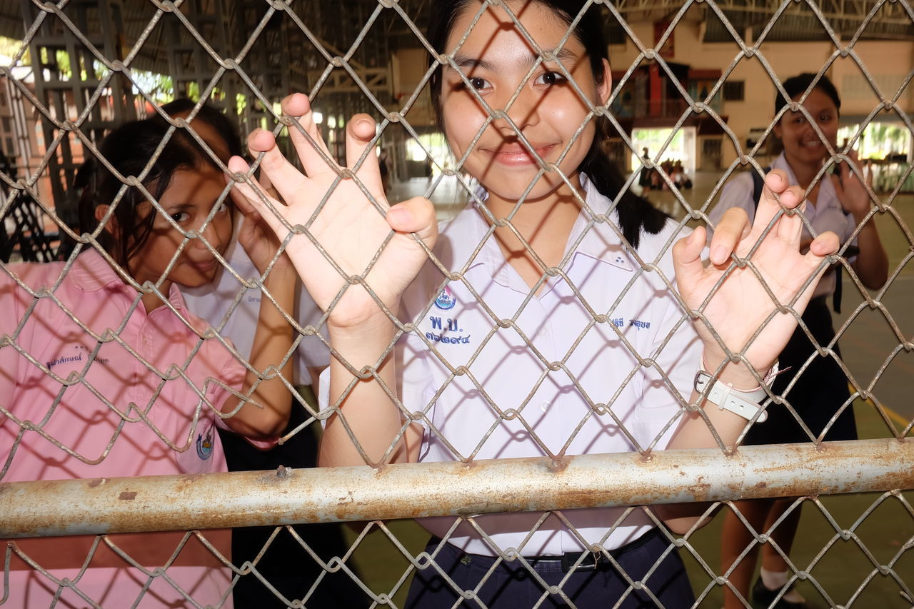 Protection Metal People Youth Culture Young Women Real People Close-up Chainlink Fence Pattern Standing EyeEm Selects Portrait Thailand
