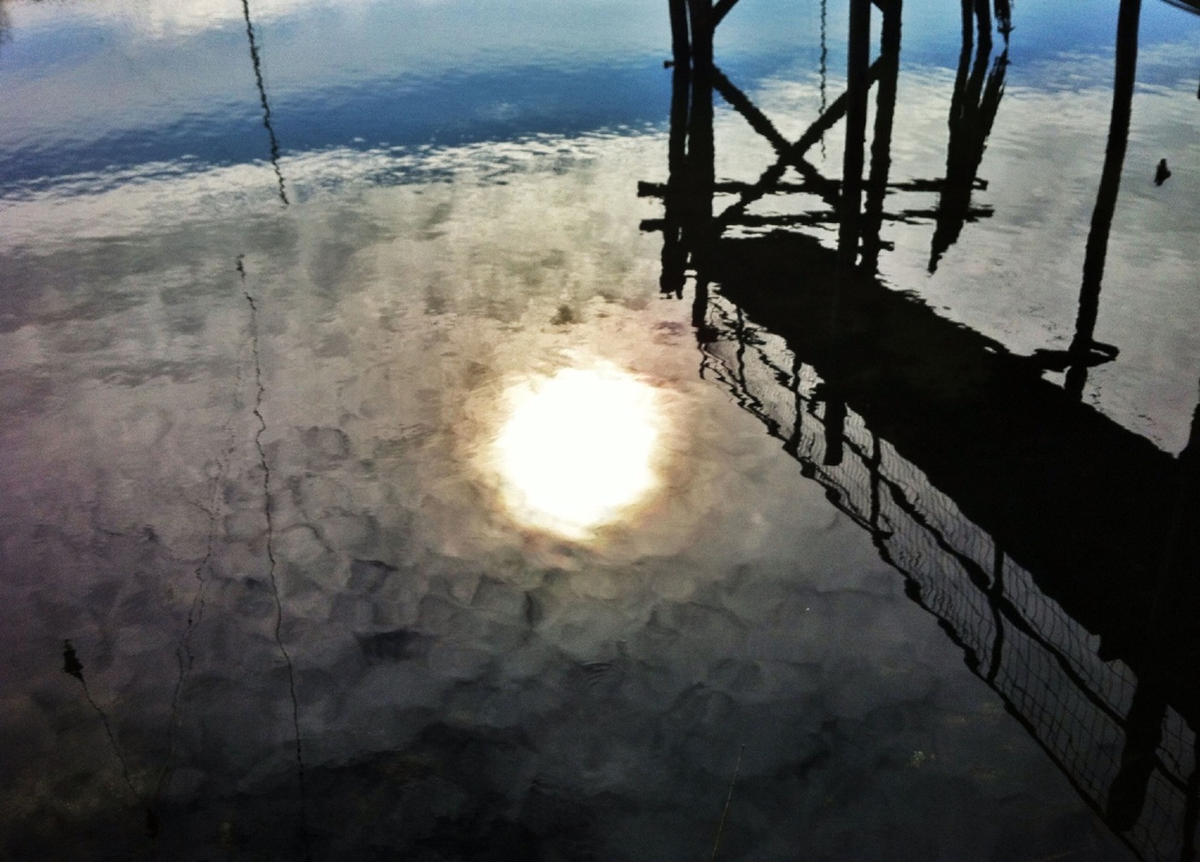 water, reflection, sea, sunset, sun, sunlight, sky, tranquility, nature, tranquil scene, sunbeam, beauty in nature, transportation, scenics, rippled, railing, pier, outdoors, nautical vessel, silhouette