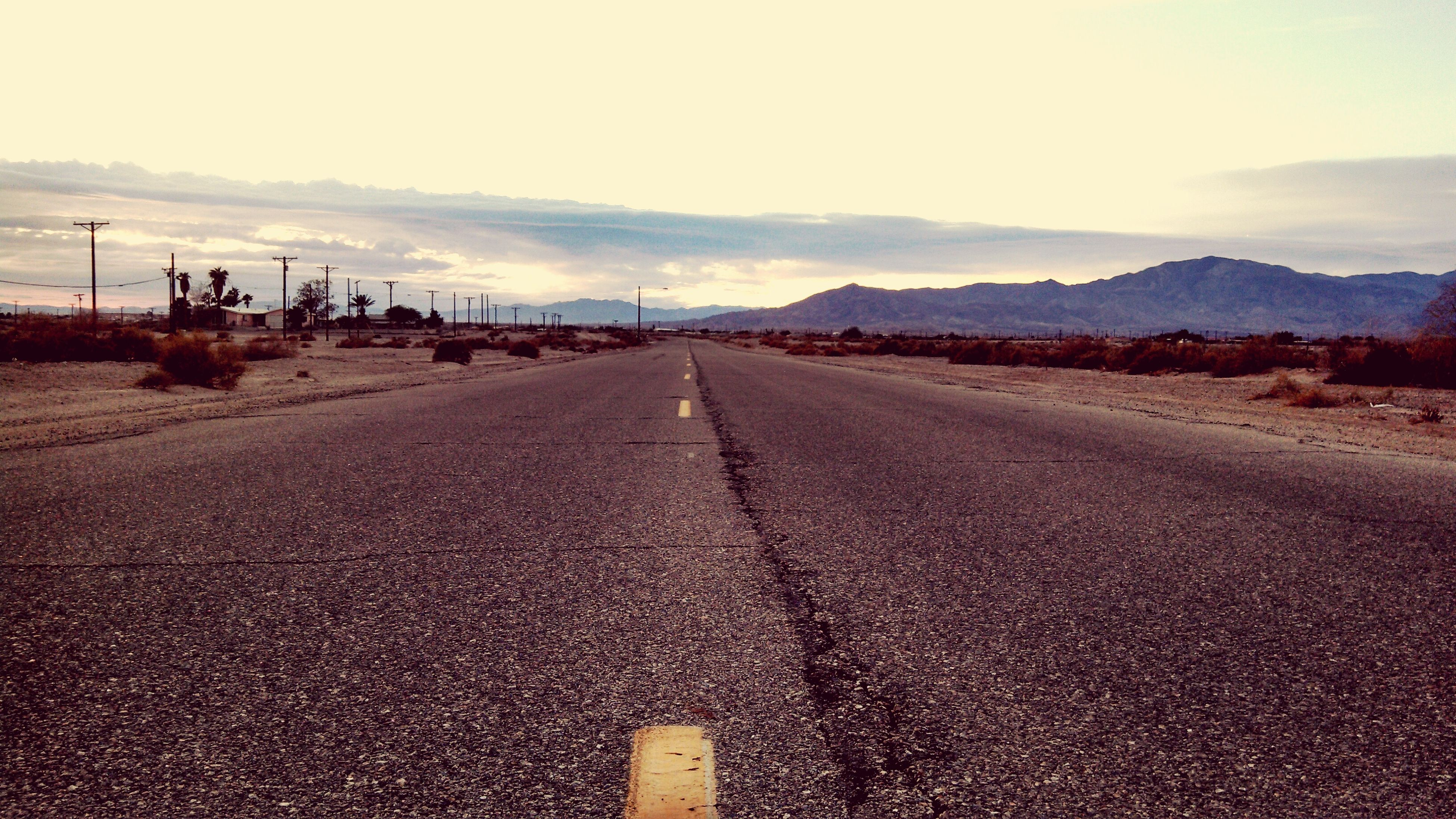 the way forward, road, sky, mountain, transportation, diminishing perspective, road marking, landscape, tranquil scene, vanishing point, tranquility, asphalt, mountain range, scenics, empty, country road, cloud - sky, nature, empty road, beauty in nature