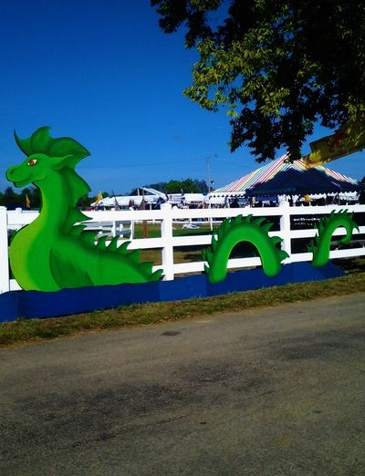 Loch Ness Monster Architecture Blue Built Structure Clear Sky Columbus, Indiana Day Empty Festival Season Grass Green Green Color Growth Highland Games Highland Games And Festival Lawn Loch Ness Monster Nature Outdoors Plant Scottish Festival Scottish Influence In Indiana Sky Sunlight Sunny Tree