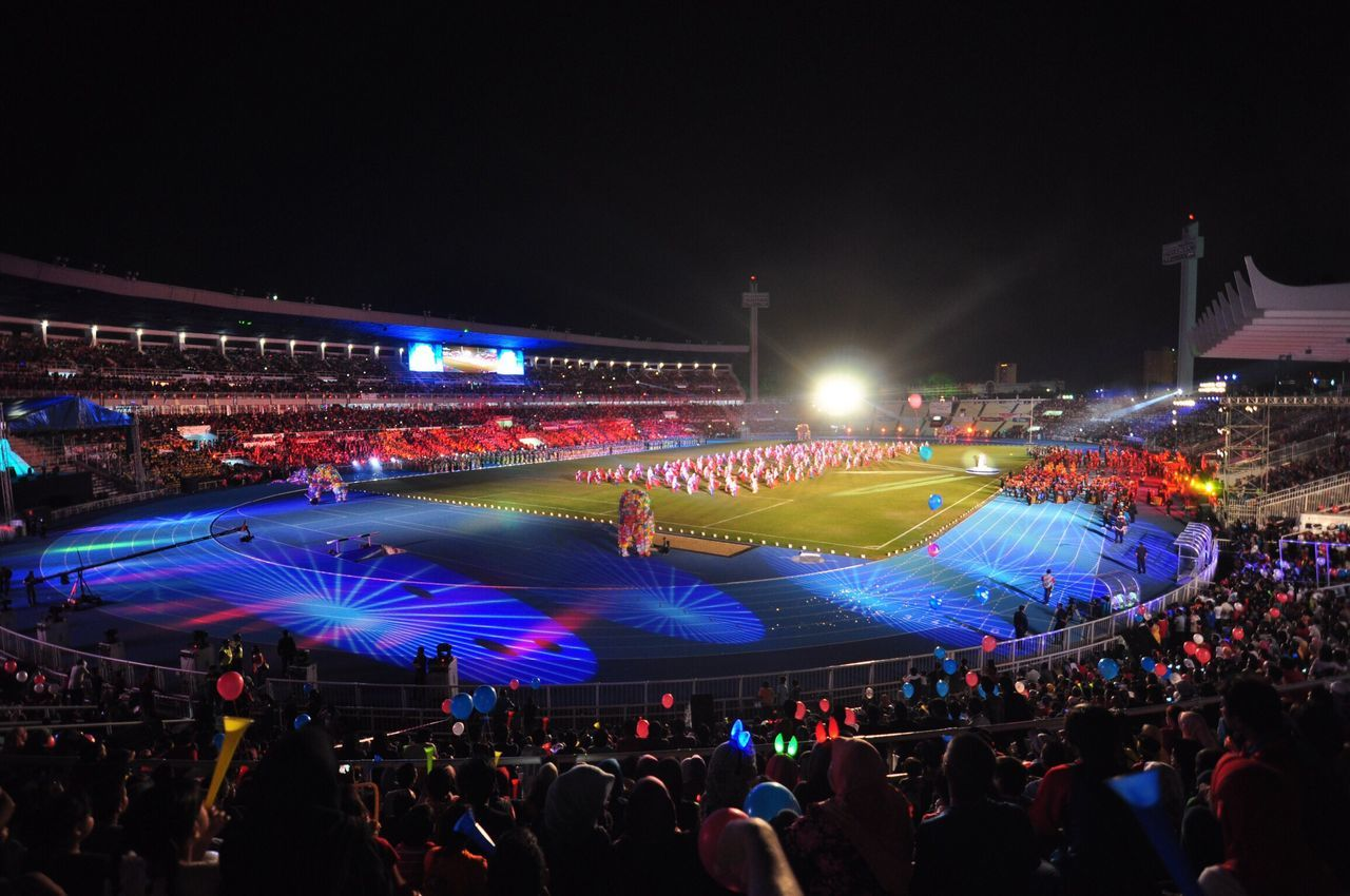 Sports SUKMA Pahang, Malaysia Crowds Lifestyles Illuminated Leisure Activity Large Group Of People Night Crowd Person Men Arts Culture And Entertainment Performance Travel Spectator Street Tourism Mixed Age Range Watching Rush Hour Event Light Beam Laser People And Places