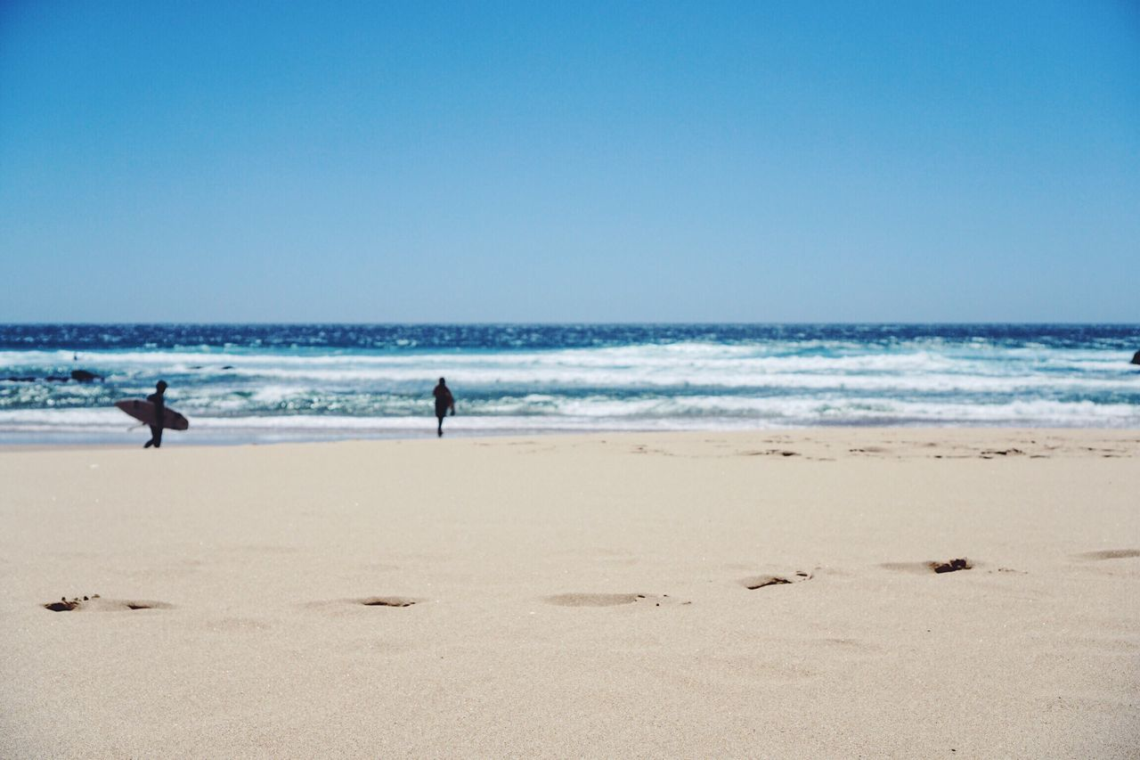 Sea Beach Real People Clear Sky Horizon Over Water Water Lifestyles Nature Sand Scenics Leisure Activity Outdoors Wave Men Day Togetherness Beauty In Nature Sky Summer Travel Destinations Surfing