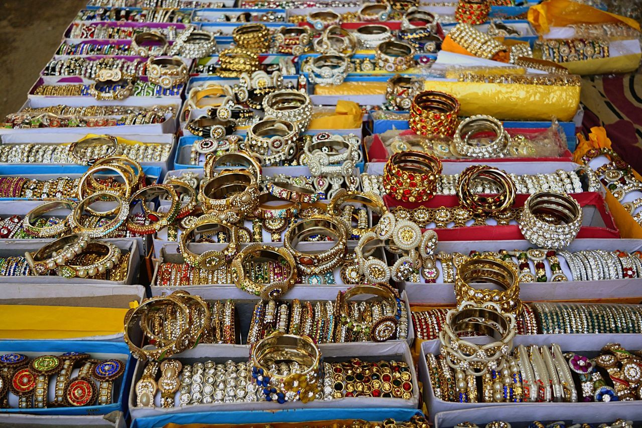 High Angle View Of Various Bangles Arranged On Stall At Market